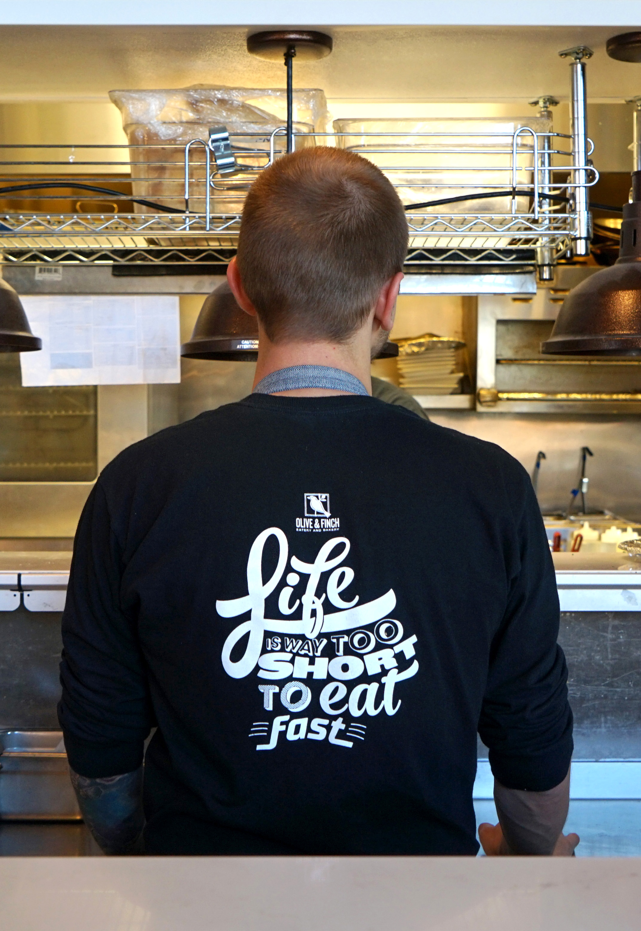 Both t-shirt designs were printed and are currently worn by the staff. The designs were printed on the back because all employees are required to wear aprons.