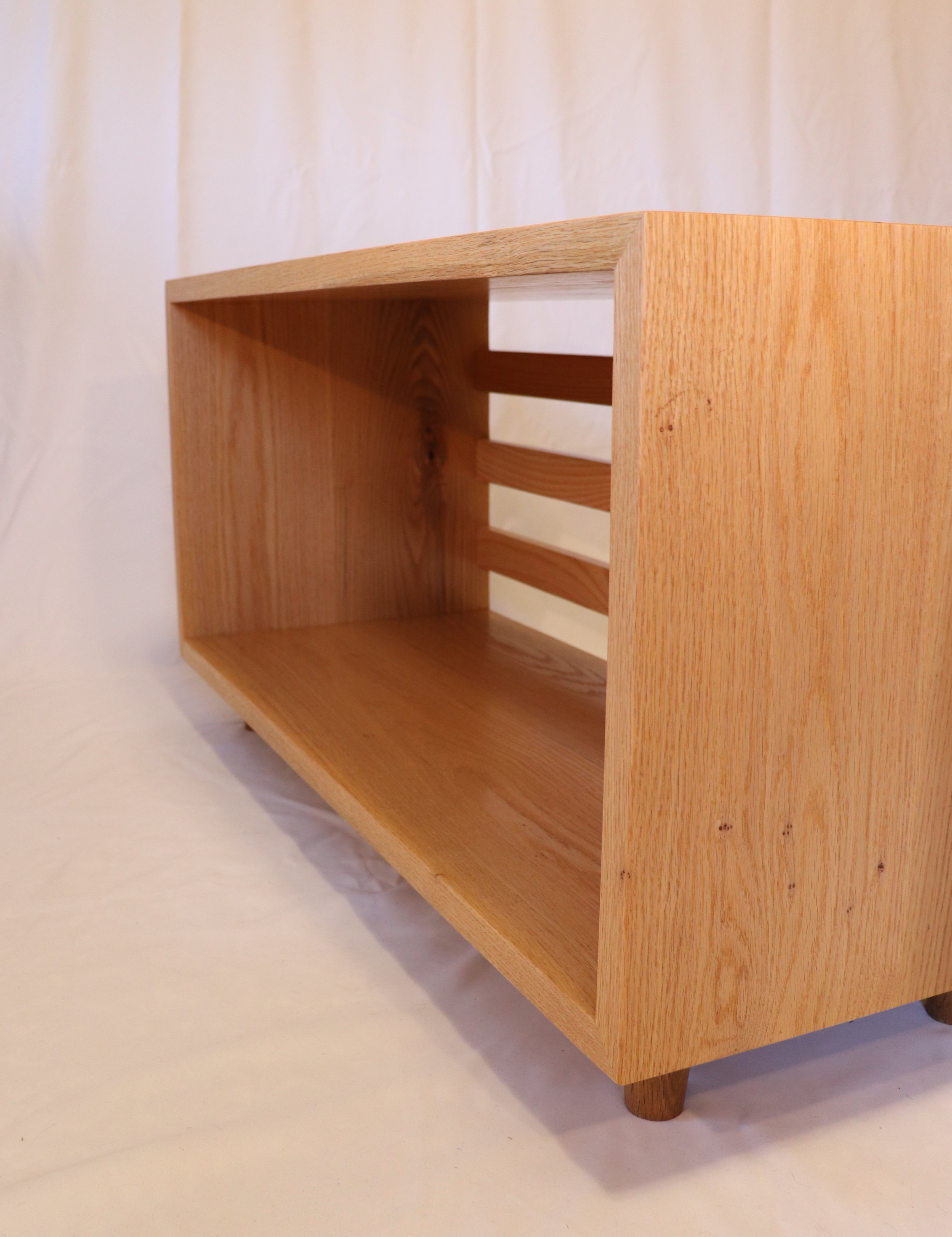 TV Console - White oak, grain wrapped miters with hidden tenons, back slats attached with lap dovetails, small turned feet at the bottom. This was a quick and dirty project to get our TV off the floor!