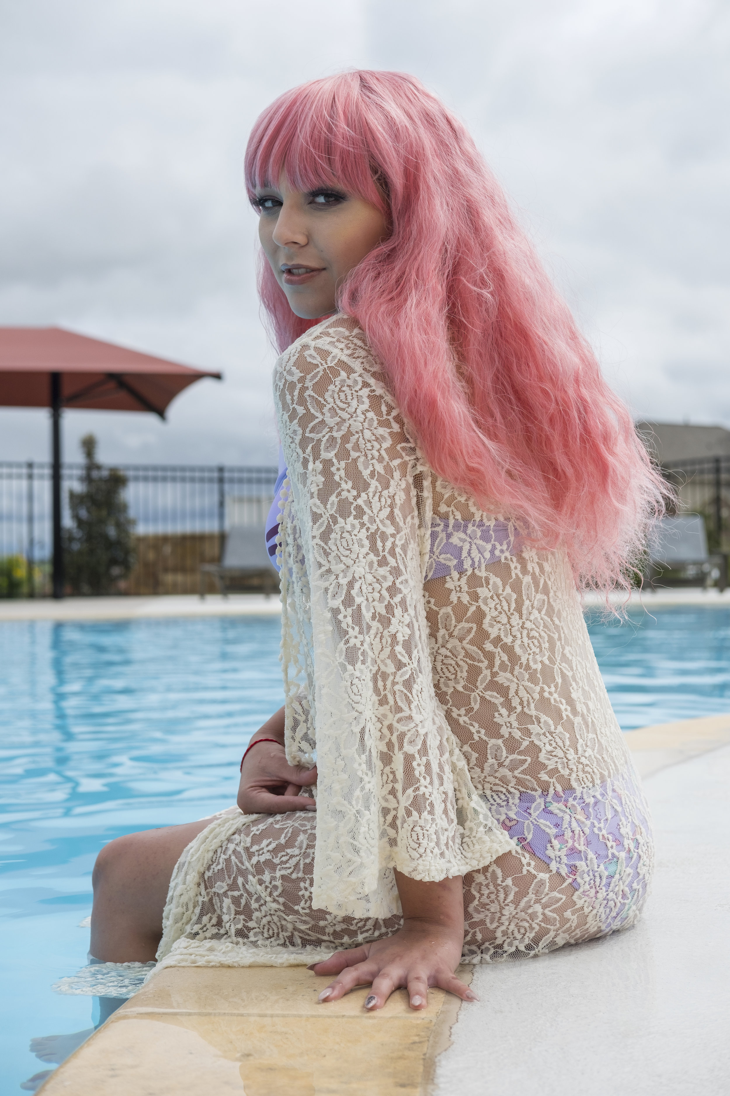 Mermaid Child in a Pusheen swimsuit at a swimming pool