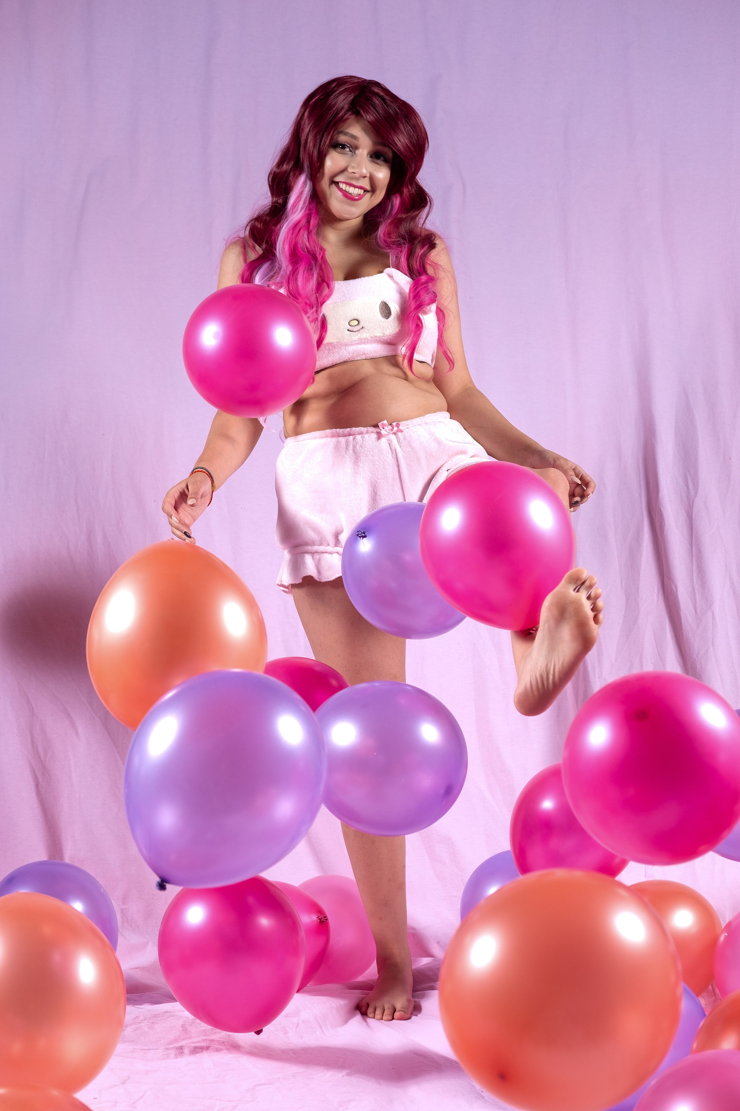 Mermaid Child kicking balloons while wearing the My Melody lingerie set from Sanrio