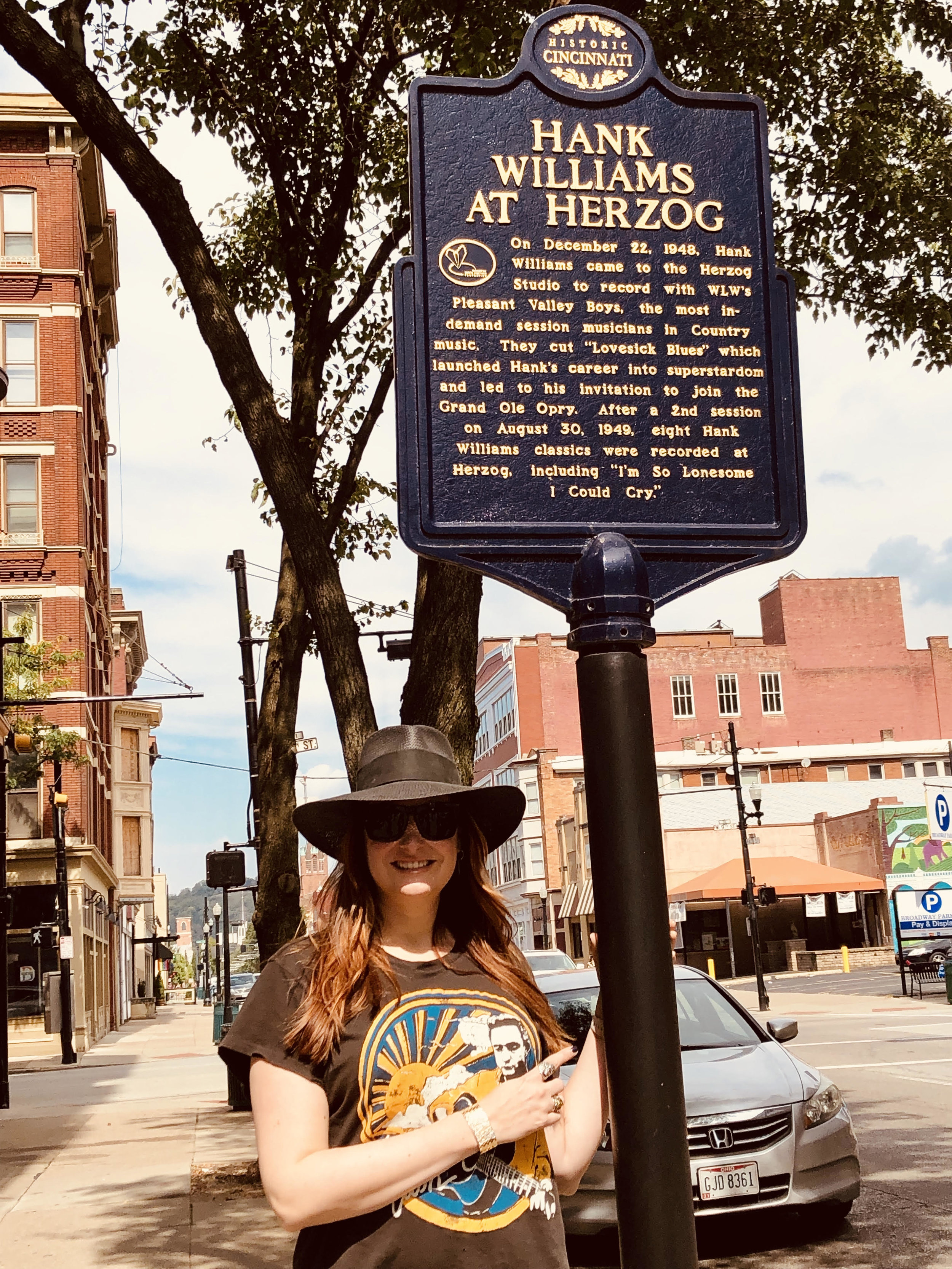 Hilary Williams with Herzog commemorative marker at 811 Race Street