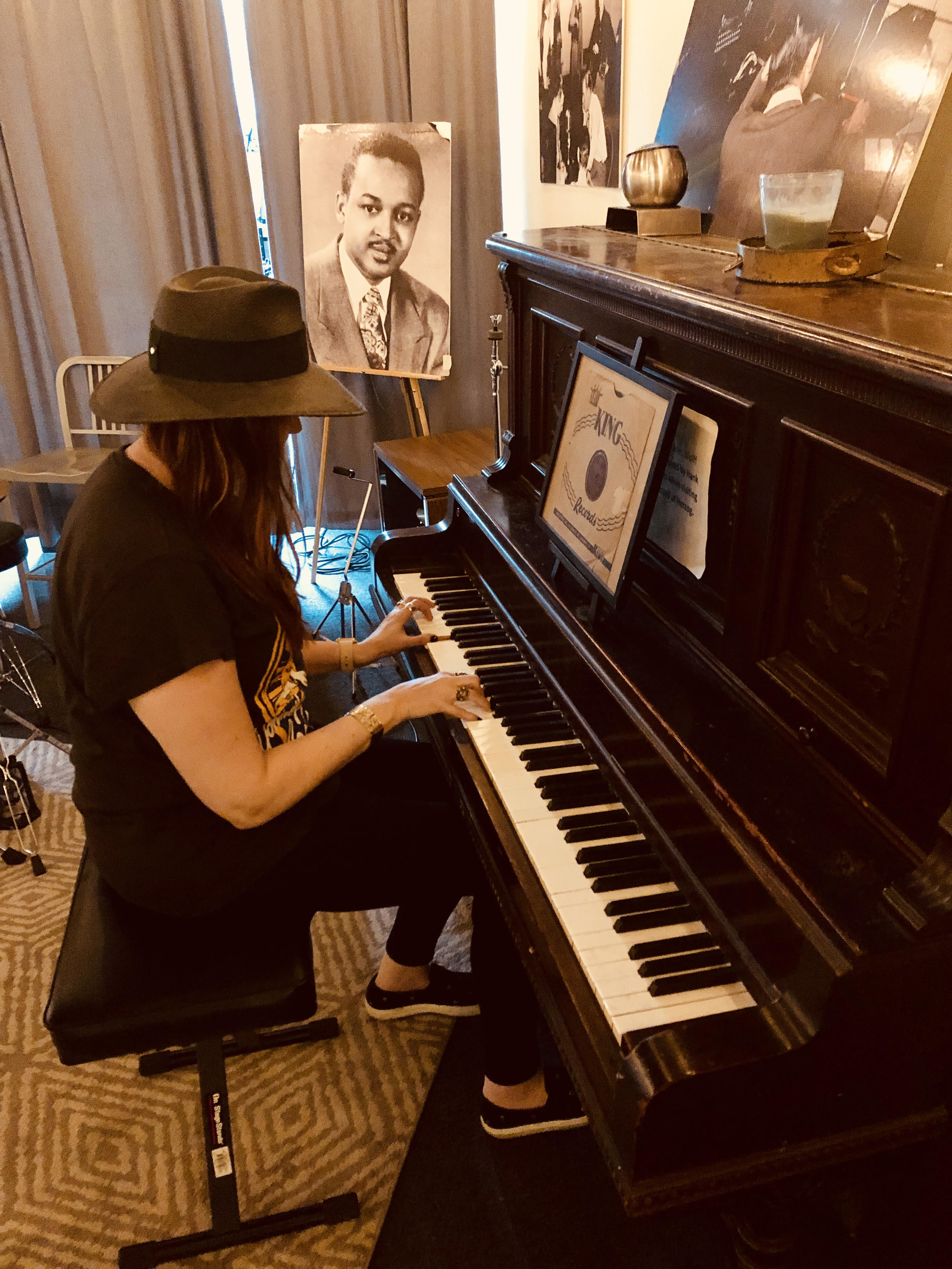 Hilary Williams at the same piano her grandfather likely used to work out arrangements