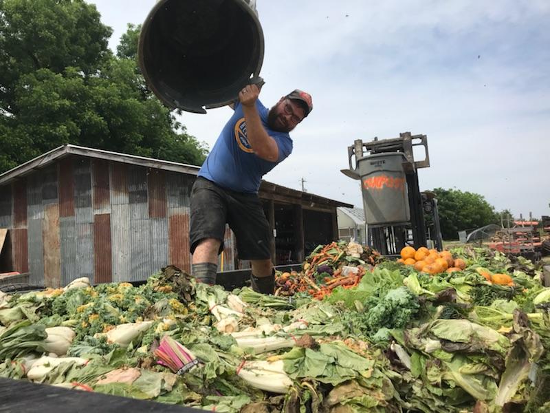 Ryan working at Johnson's Backyard Garden in 2018.
