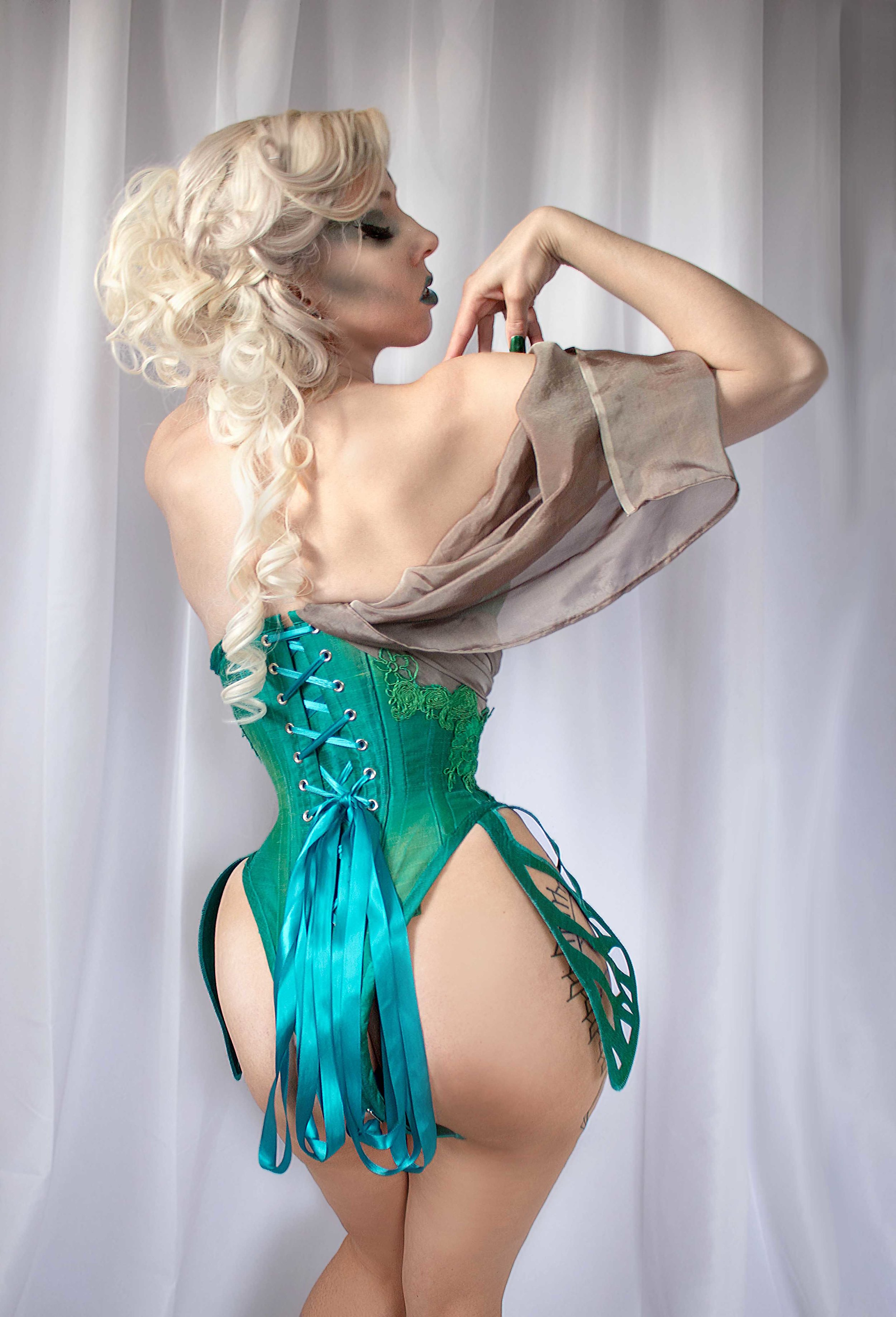 Exoskeleton - Whether a corset is being laced up or removed, it often does hint at a sort of nature-defying transformation.