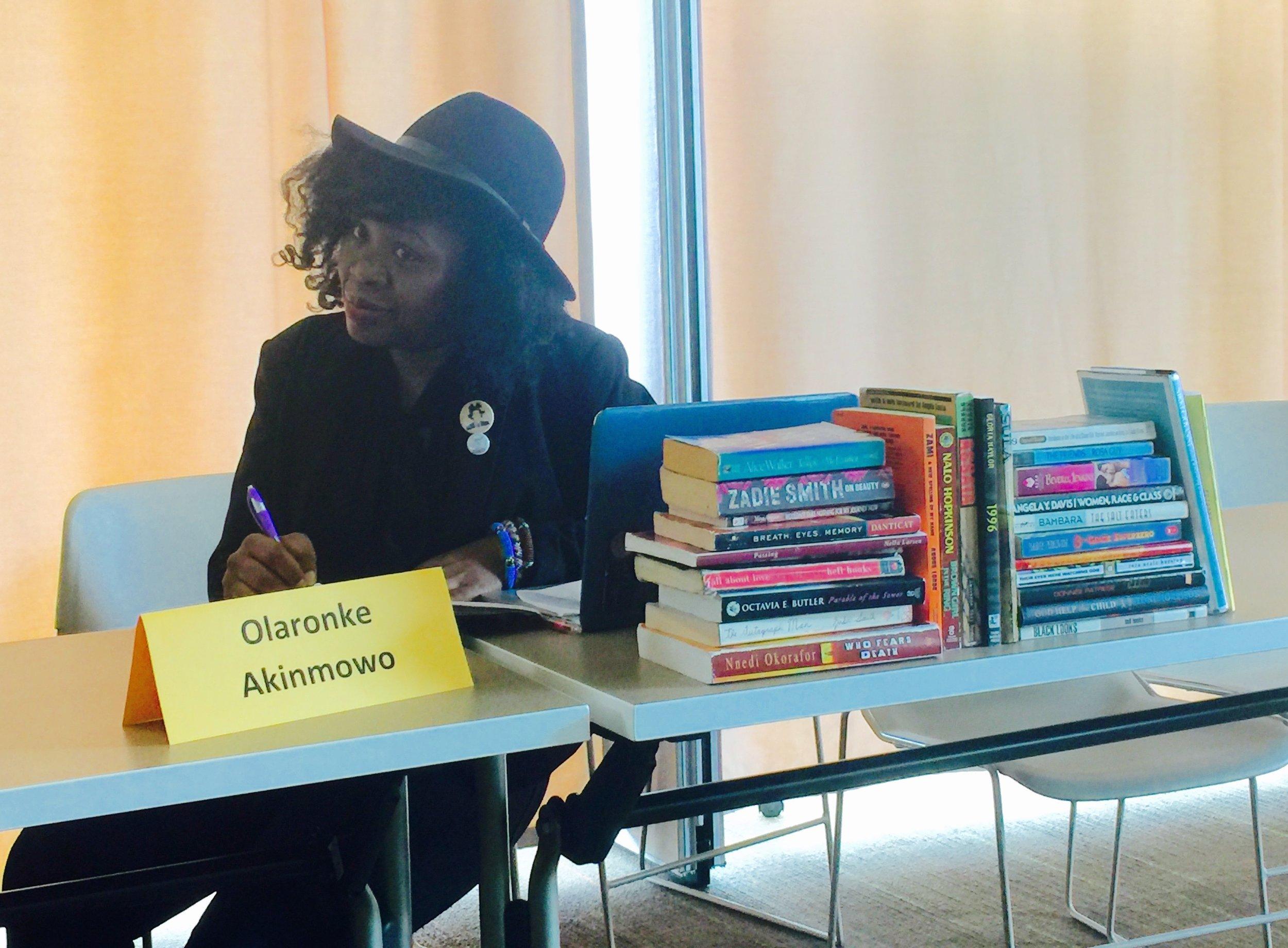 Olaronke Akinmowo with books.jpg
