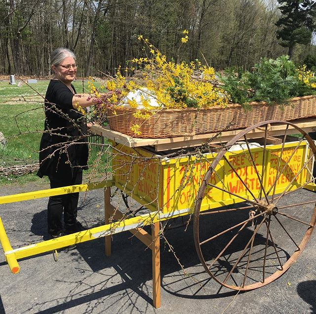 A passionate environmentalist, we drive out to the country and put my father-in-law into the earth in a wicker casket covered in flowers.