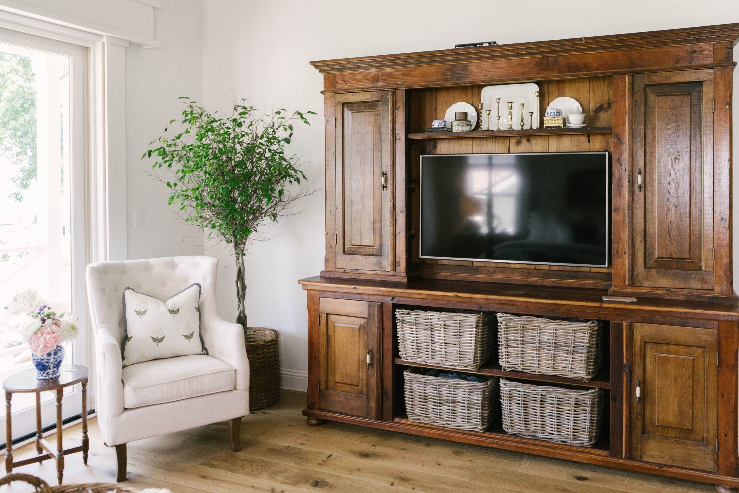 Classic Farmhouse Home Tour - Master Bedroom - Vintage Hutch Turned Entertainment Center