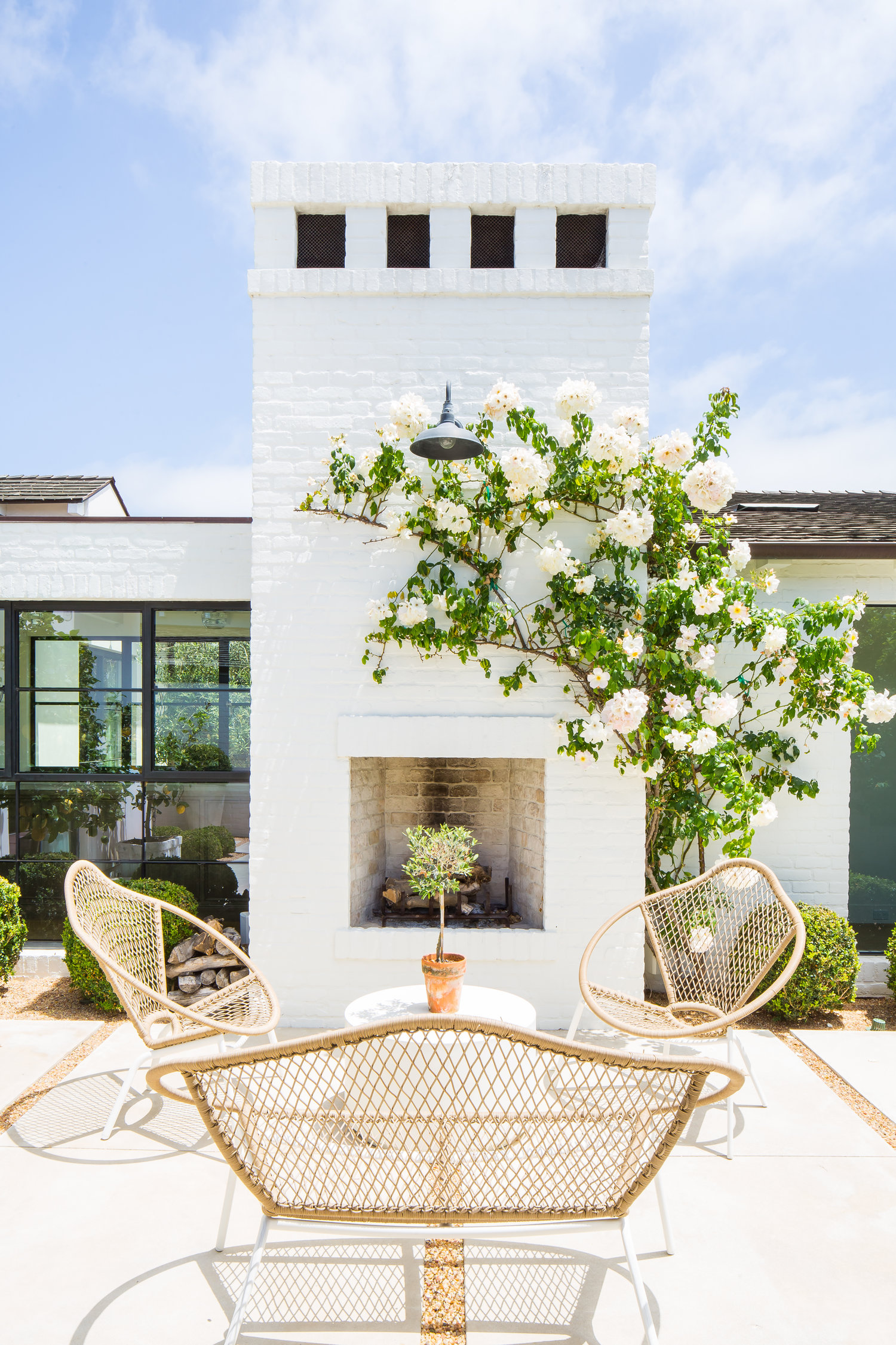Modern Farmhouse Back Porch with Fireplace - Kelly Nutt Design .jpg