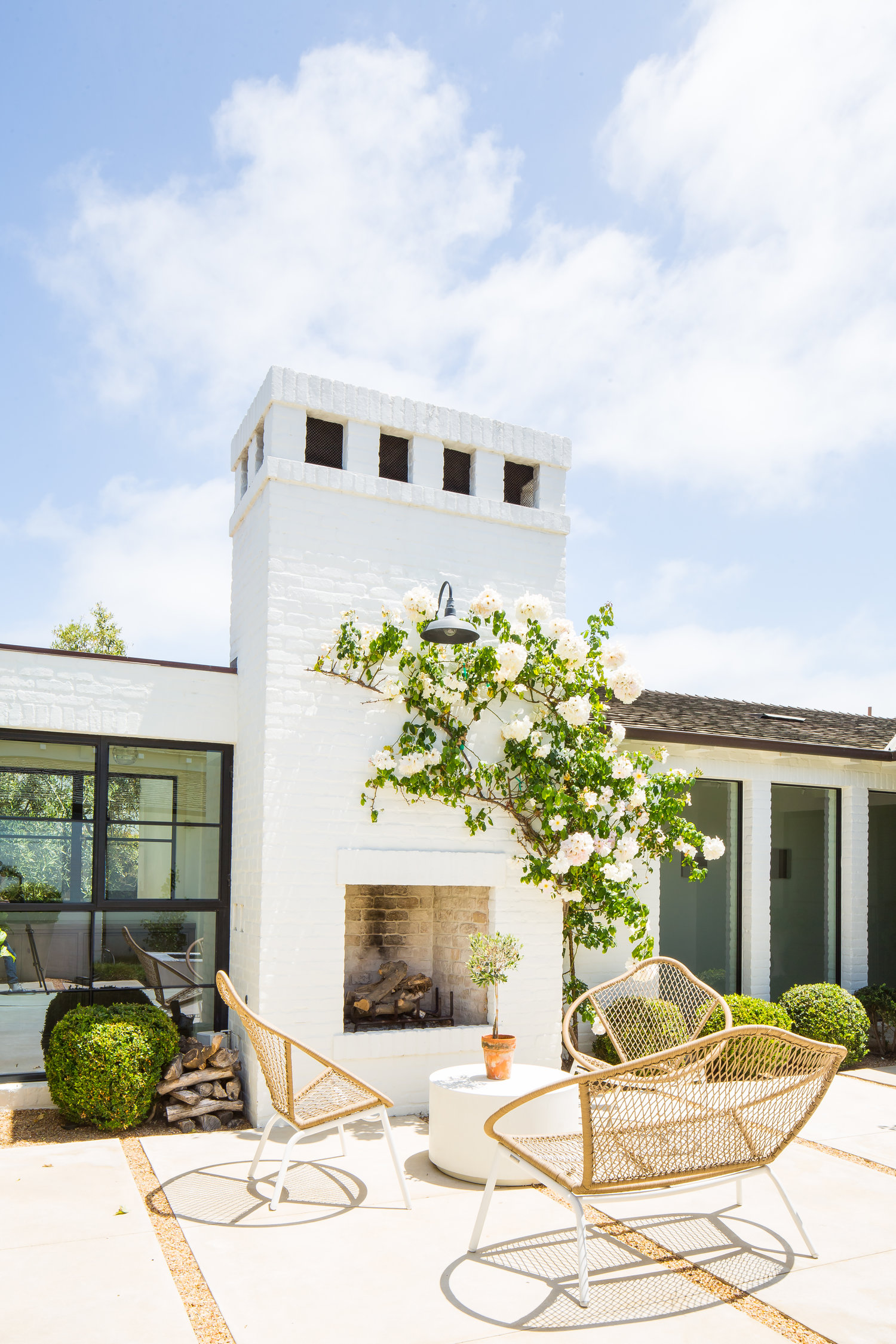 Modern Farmhouse Back Porch with Fireplace - Kelly Nutt Design.jpg