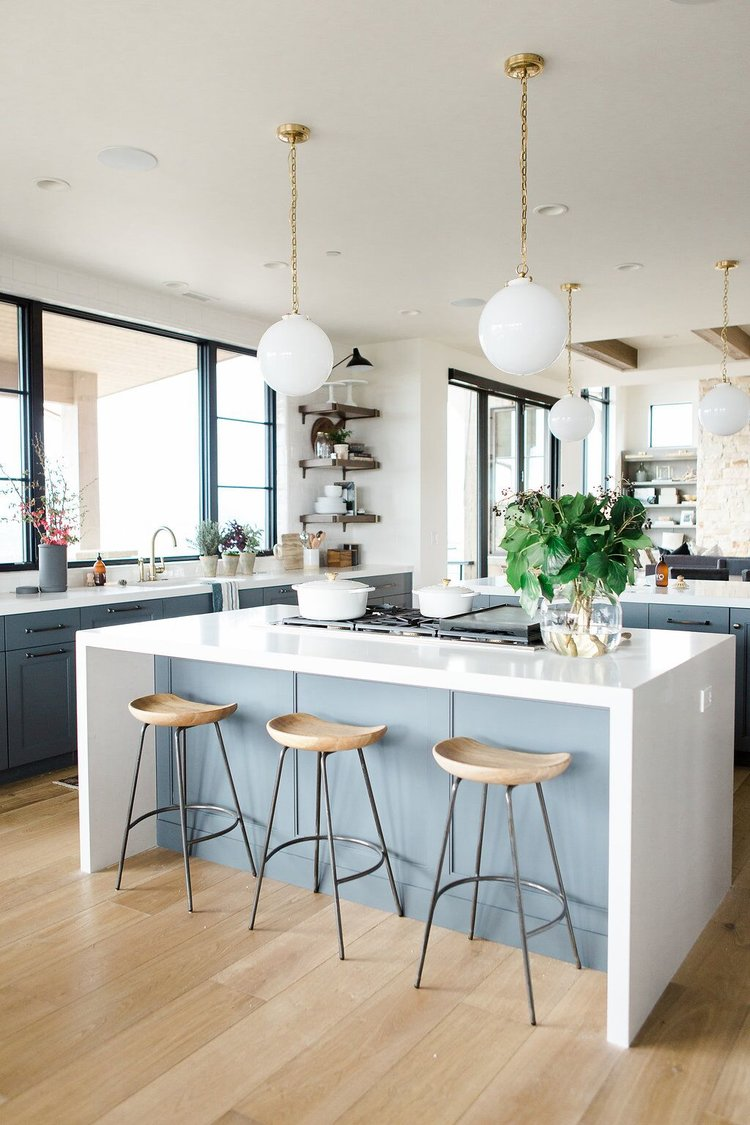 25Modern+kitchen+with+open+shelves,+natural+wood+barstools,+blue+cabinets+with+white+waterfall+edged+countertops.jpeg