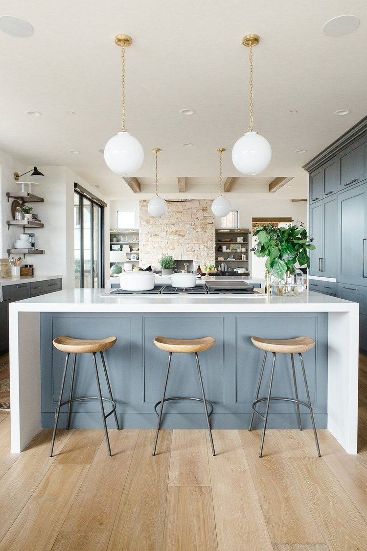 26Modern+kitchen+with+open+shelves,+natural+wood+barstools,+blue+cabinets+with+white+waterfall+edged+countertops.jpeg