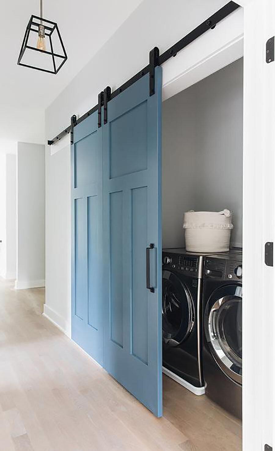hallway-closet-laundry-room-with-barn-door-on-rails.jpg
