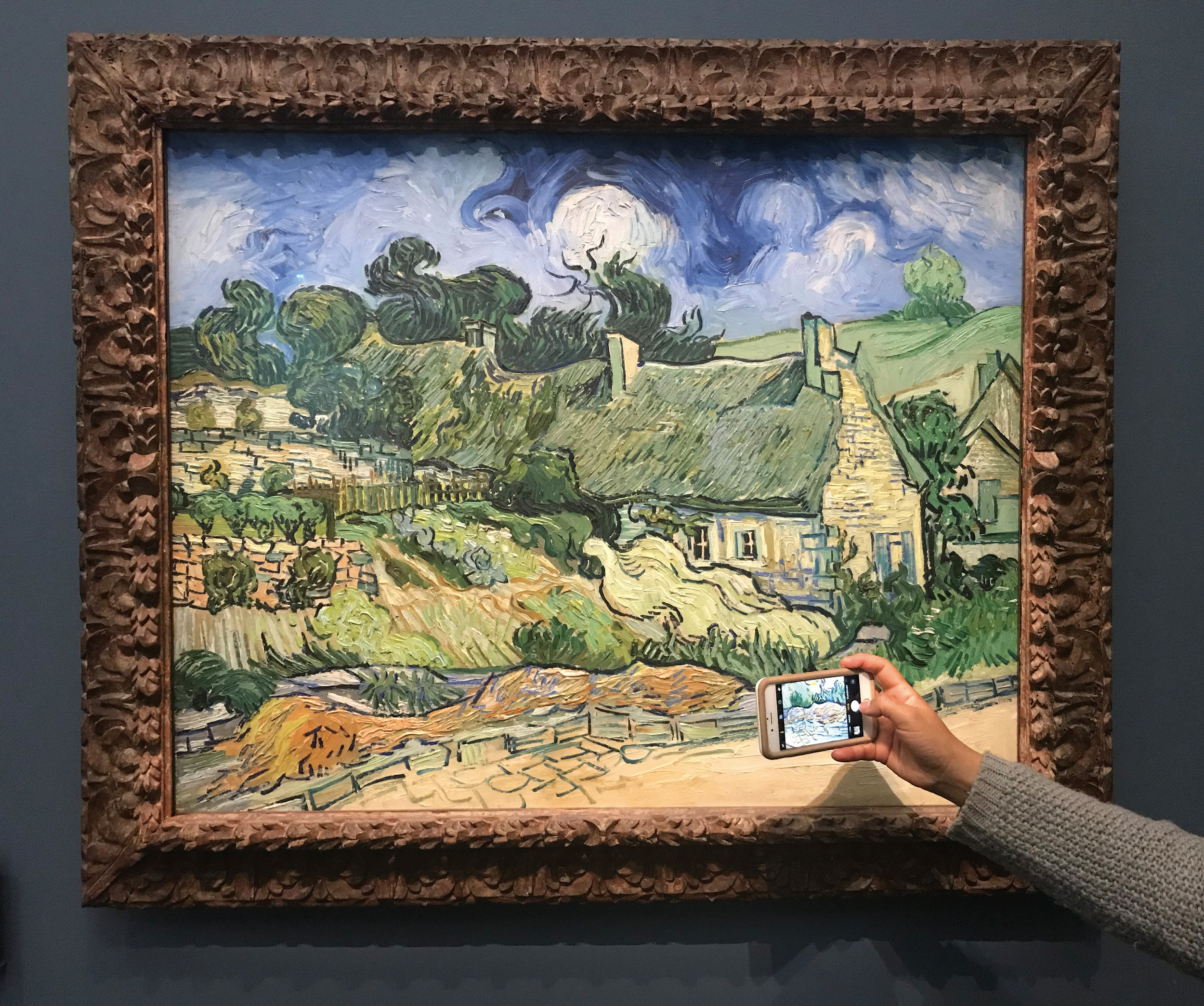 Somebody getting close to Thatched Cottages at Cordeville (1890) by Vincent van Gogh