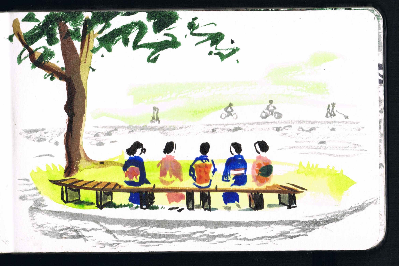 Ladies in kimono sat by the Kamo River in Kyoto