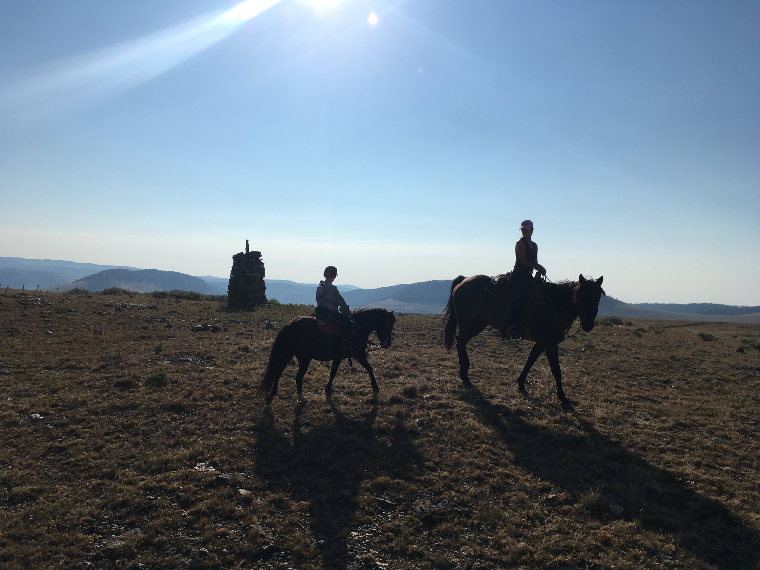 Quinlan and I at the top of the pasture with a Sheepherders' Monument.