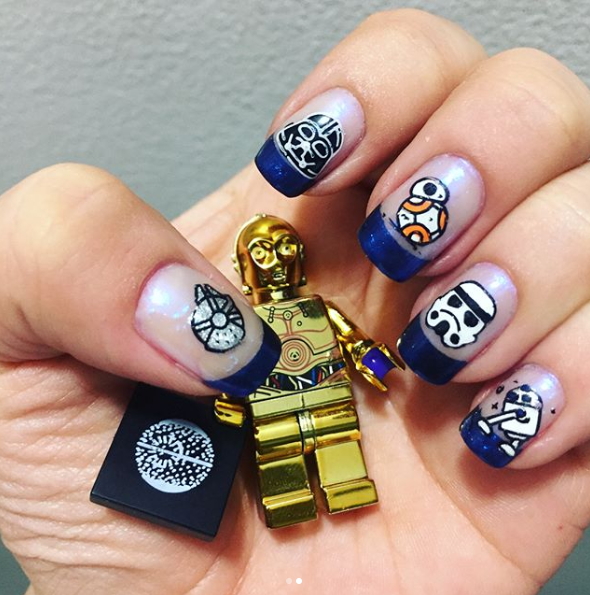 French manicure and more - Love these blue metallic tipped french manicure nails with R2, BB-8, Storm Trooper and Darth Vader. It is an interesting use of natural nail to showcase the artwork.