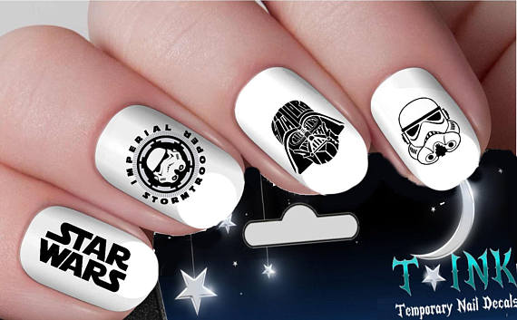These are the stickers you're looking for - If you're daunted by using lacquers and polishes to create solid Star Wars imagery, stickers or wraps may be your best bet.These nail stickers off of Etsy are cute and accomplish the art without the hassle.
