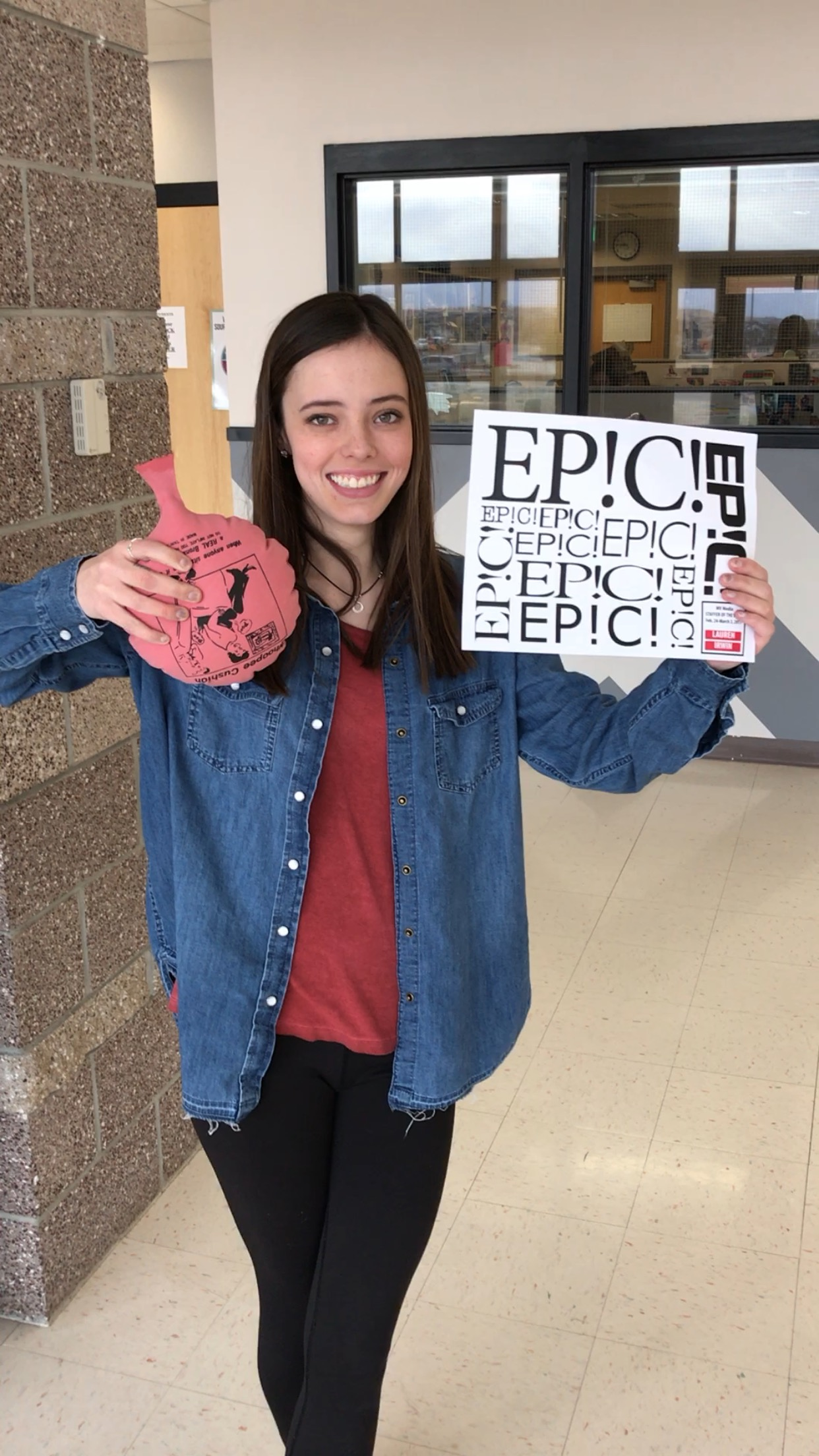 """This is a picture of me when I was awarded the title of """"Staffer of the Week."""" This was a big accomplishment for me due to the mass amount of content I did to be awarded it. It may seem insignificant to some, but being recognized by editors and mentors was important. I even have the poster hanging on my bulletin board in my bedroom."""