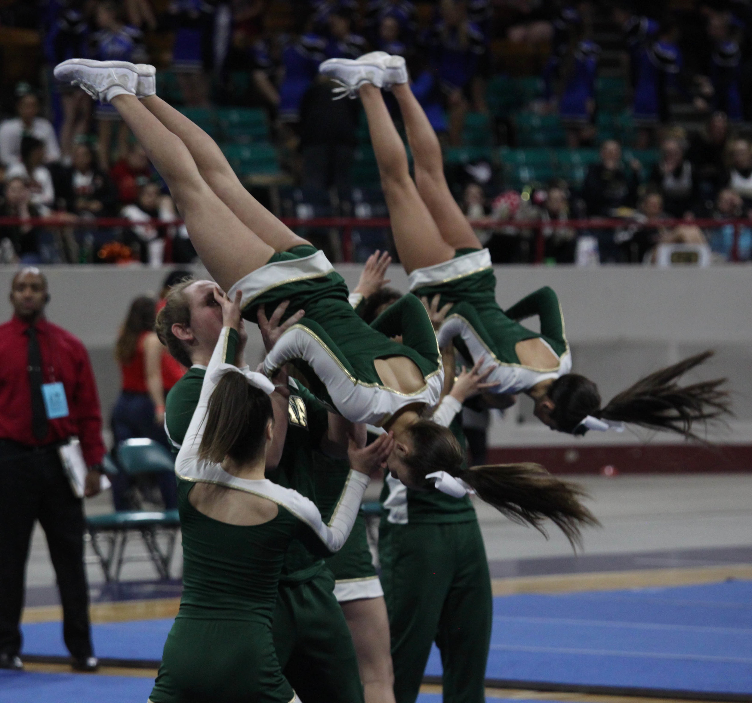 Vista cheerleaders preform during the state competition at the Denver Coleseum.