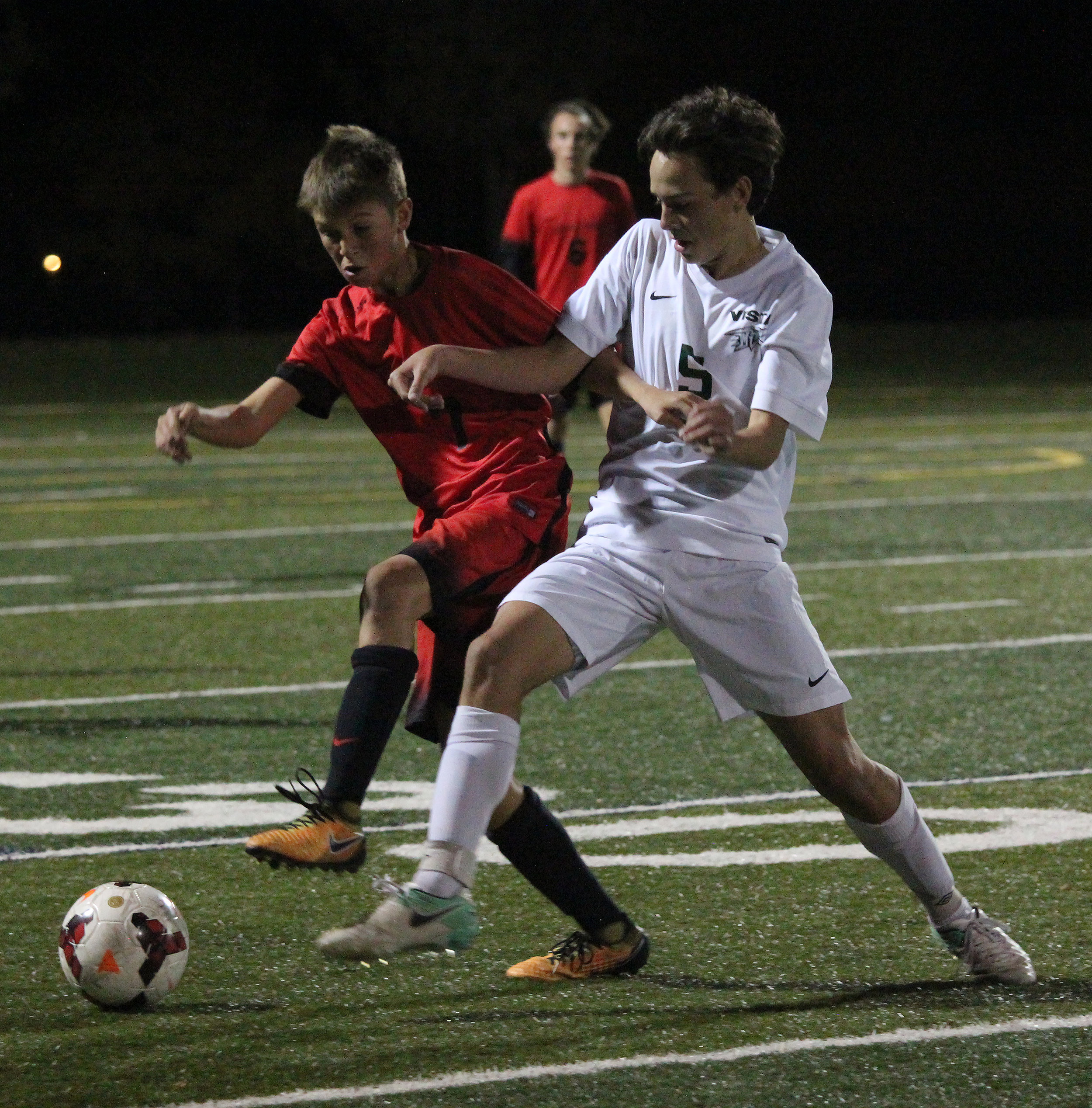 Sophomore Dante Amicarella battles for the ball against a Castle View player in the last home game of the season.