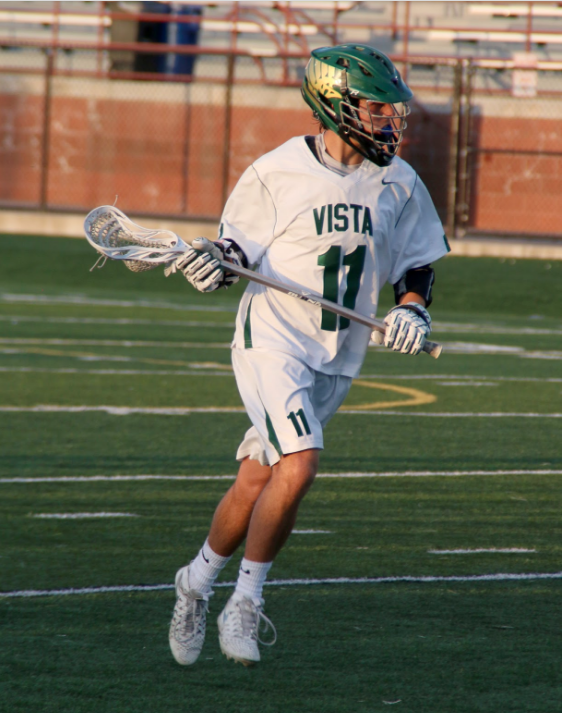 Senior Brad Oren cradles the ball in his last home game of his lacrosse career.