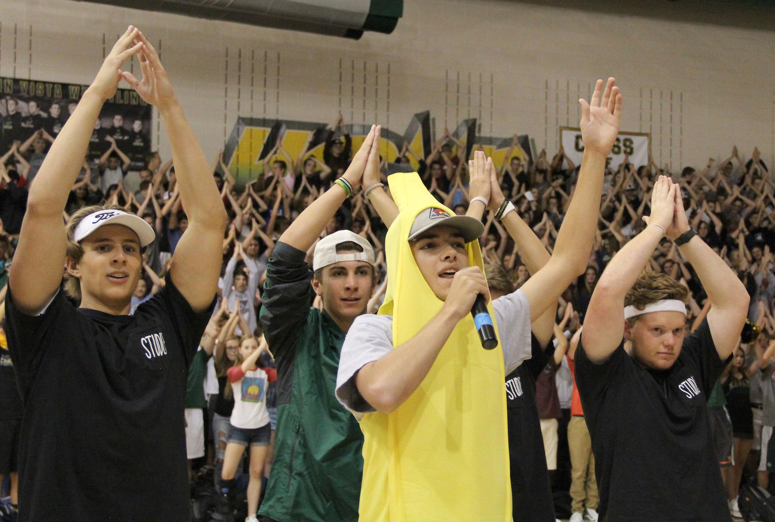 "Senior Brandon Blais leads the student body in the ""Bananas"" cheer."