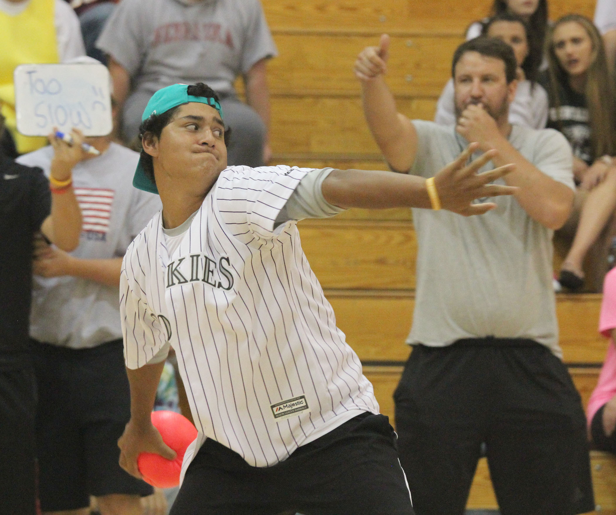 Junior Elisandro Aragon winds up for a toss in the annual homecoming dodgeball tournament.