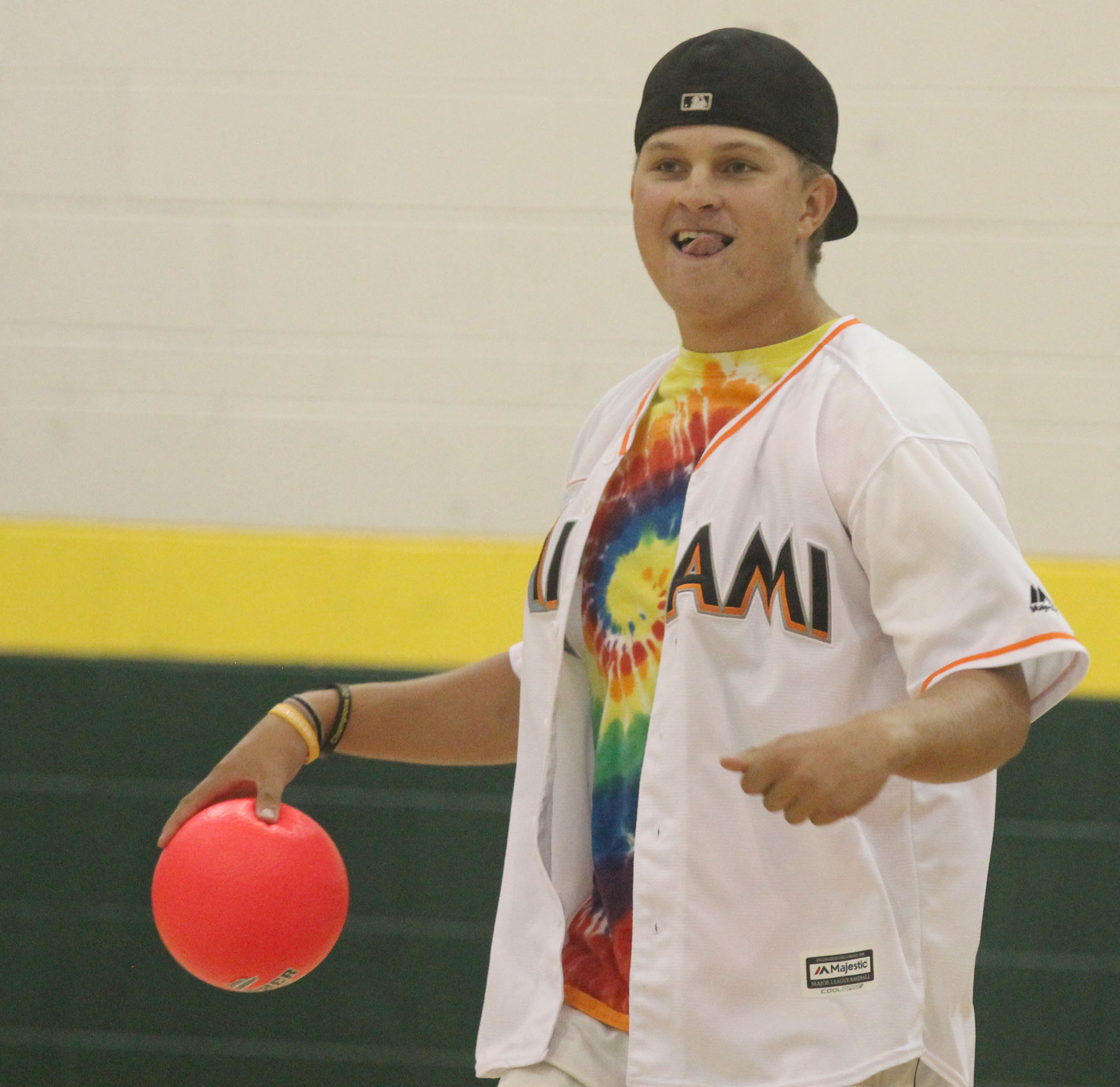 Senior Jack Liffrig celebrates after a team win in the annual homecoming dodgeball tournament.