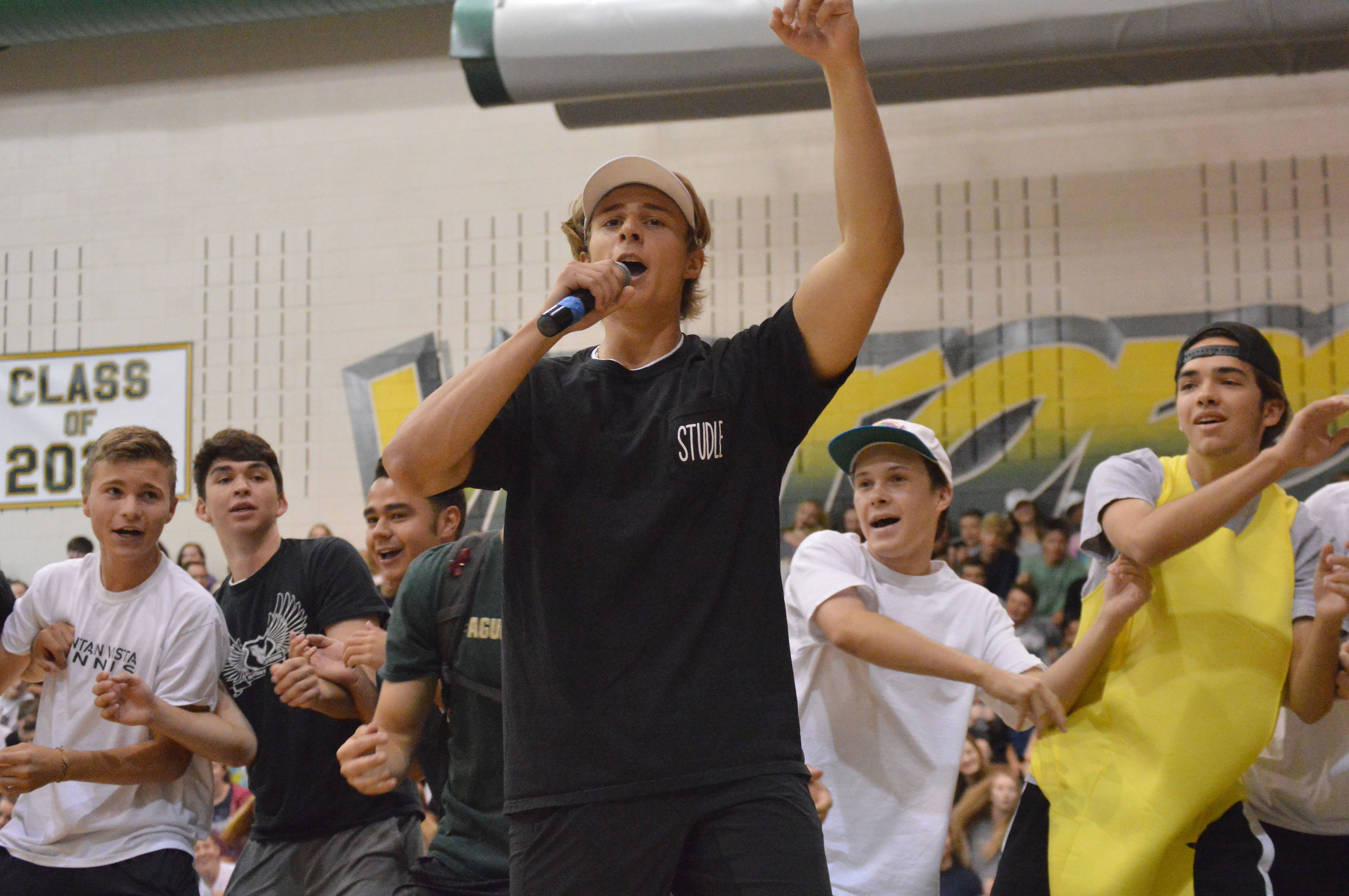 """Senior Jake Stein leads the student body in the famous """"Rafting"""" cheer."""