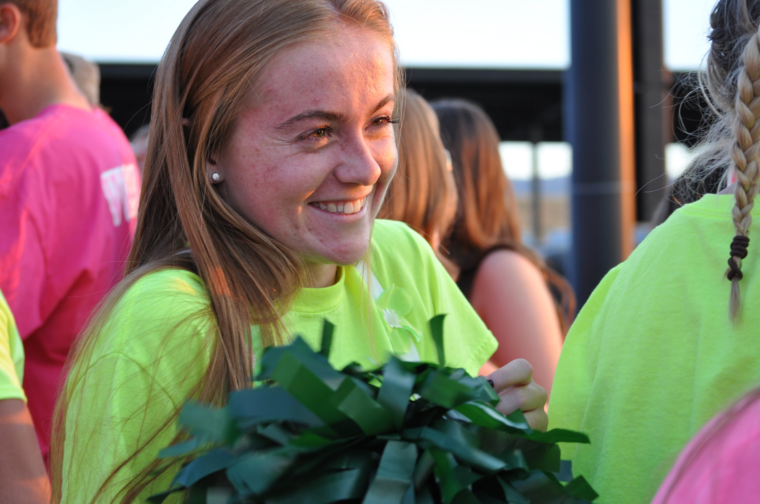 Senior Haley Schueppert smiles at the first home football game of the season.
