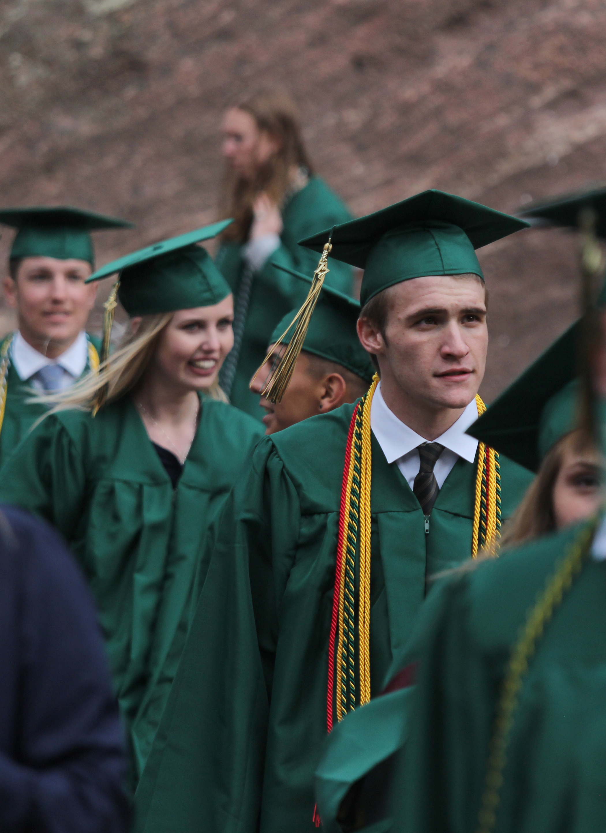 Senior Partick Mallin walks down the steps at Red Rocks before his high school graduation.