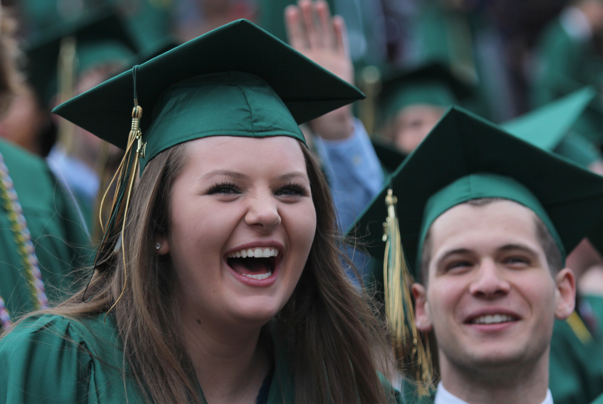 Senior Cassandra Reed laughs at speeches from her former classmates at the 2017 Red Rocks graduation.
