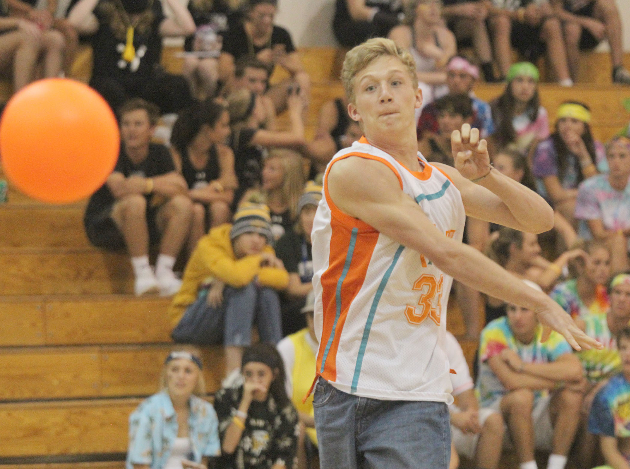 Junior Jack McFarlane tosses a dodgeball in the annual homecoming tournament.