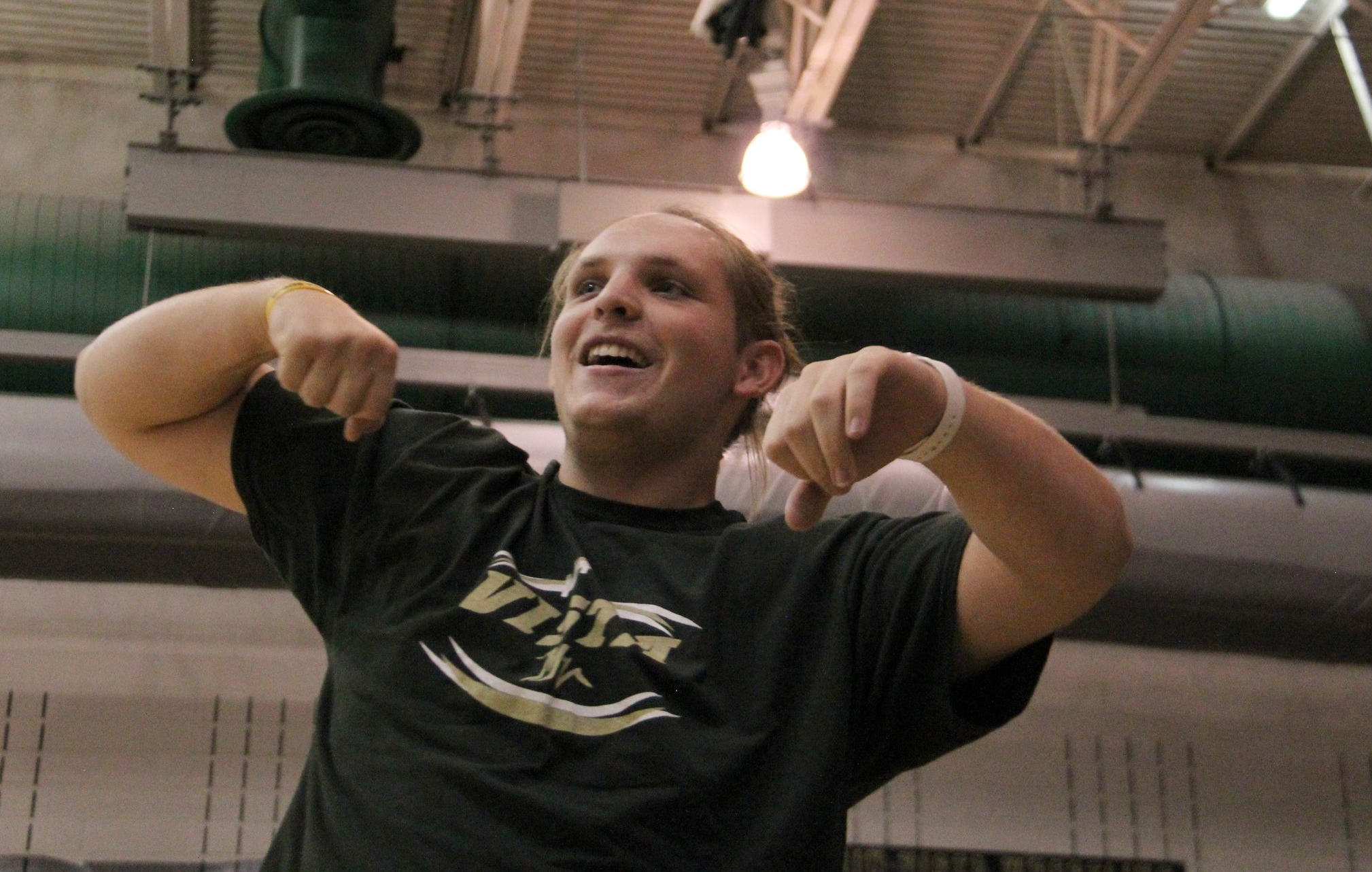 """Senior Chris Yockey celebrates after winning the """"Yea Boi"""" competition at the homecoming assembly."""