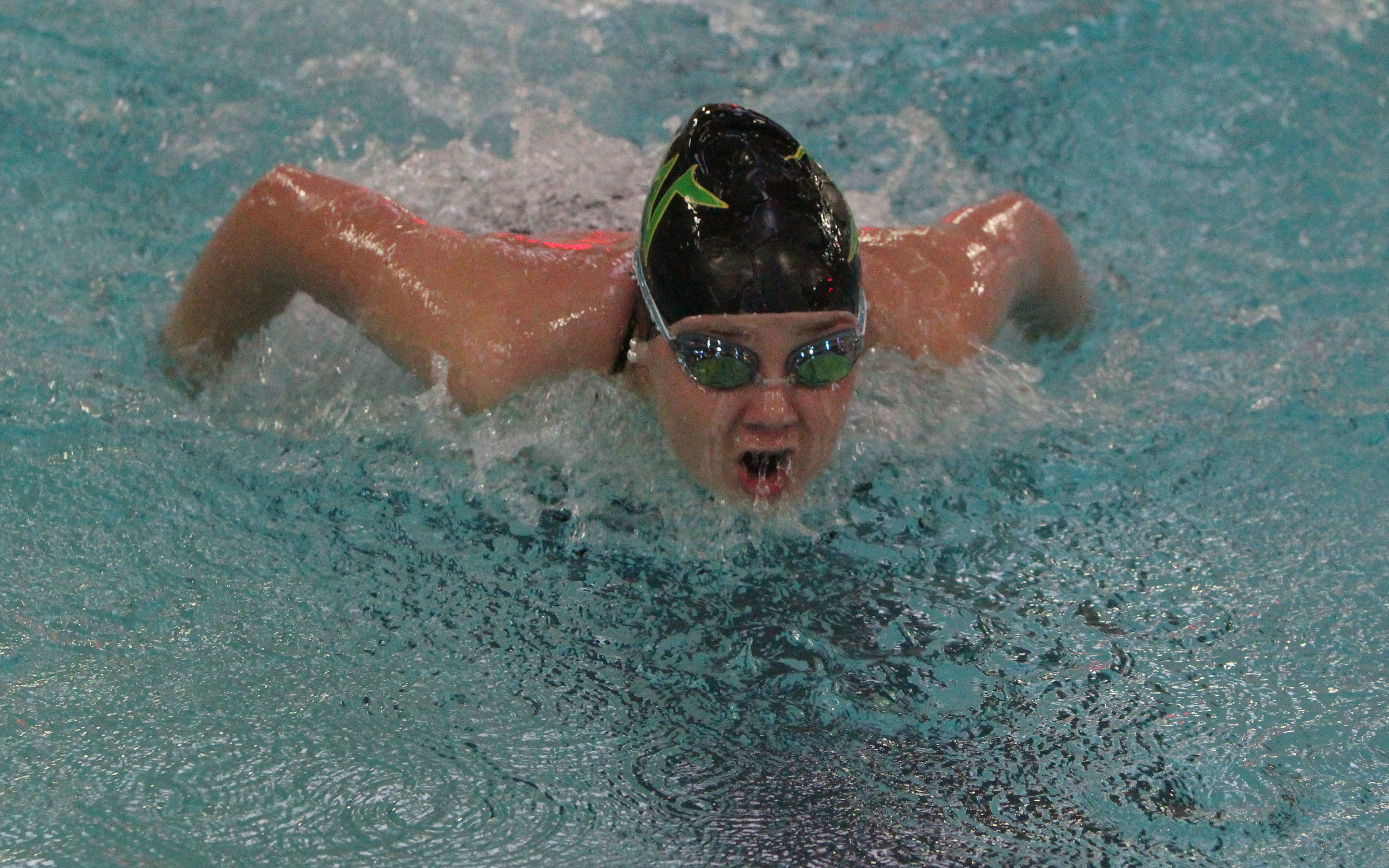 Junior Meagan Malleri comes up for air in the last home swim meet of the season.