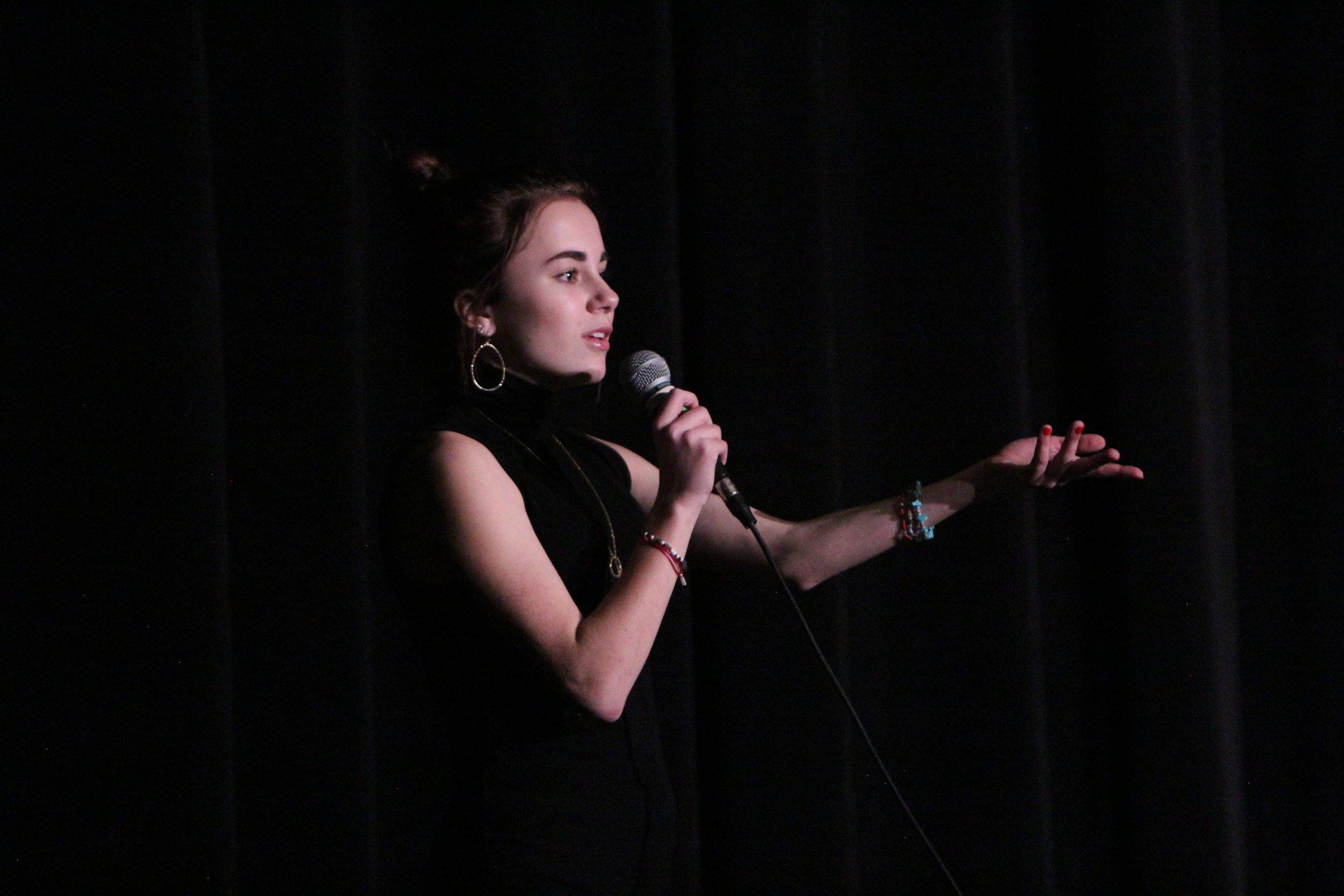 Sophomore Emma Holt preforms her original poem at the annual slam poetry competition put on by the English department.