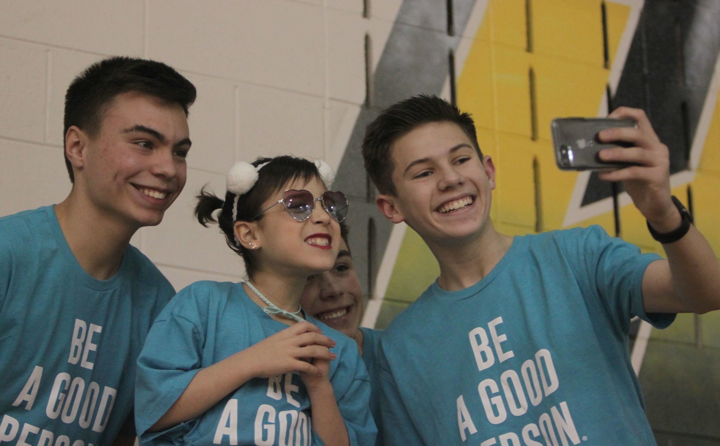 Sophomores pose for a selfie with 2018 Wish Kid, Gabby.