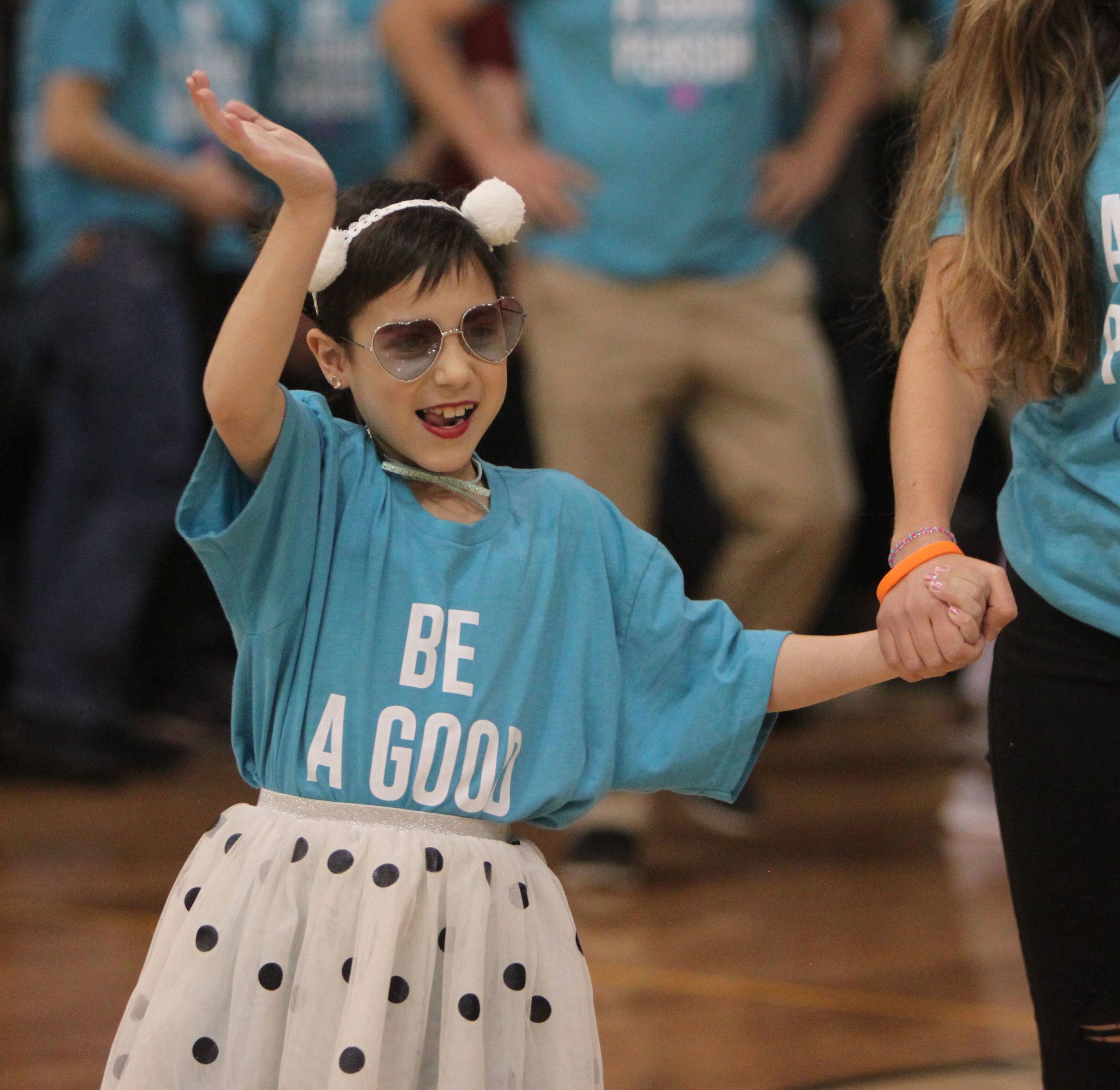 """Gabby Kovach, Vista's 2018 Wish Kid waves to her fans at the """"Reveal Assembly"""" where Vista presented her and the Make-A-Wish Foundation with over $158,000."""