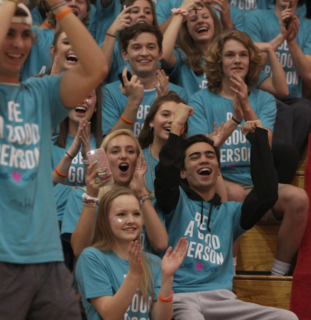 Mountain Vista seniors react to the halftime dance during the Wish Week basketball game.