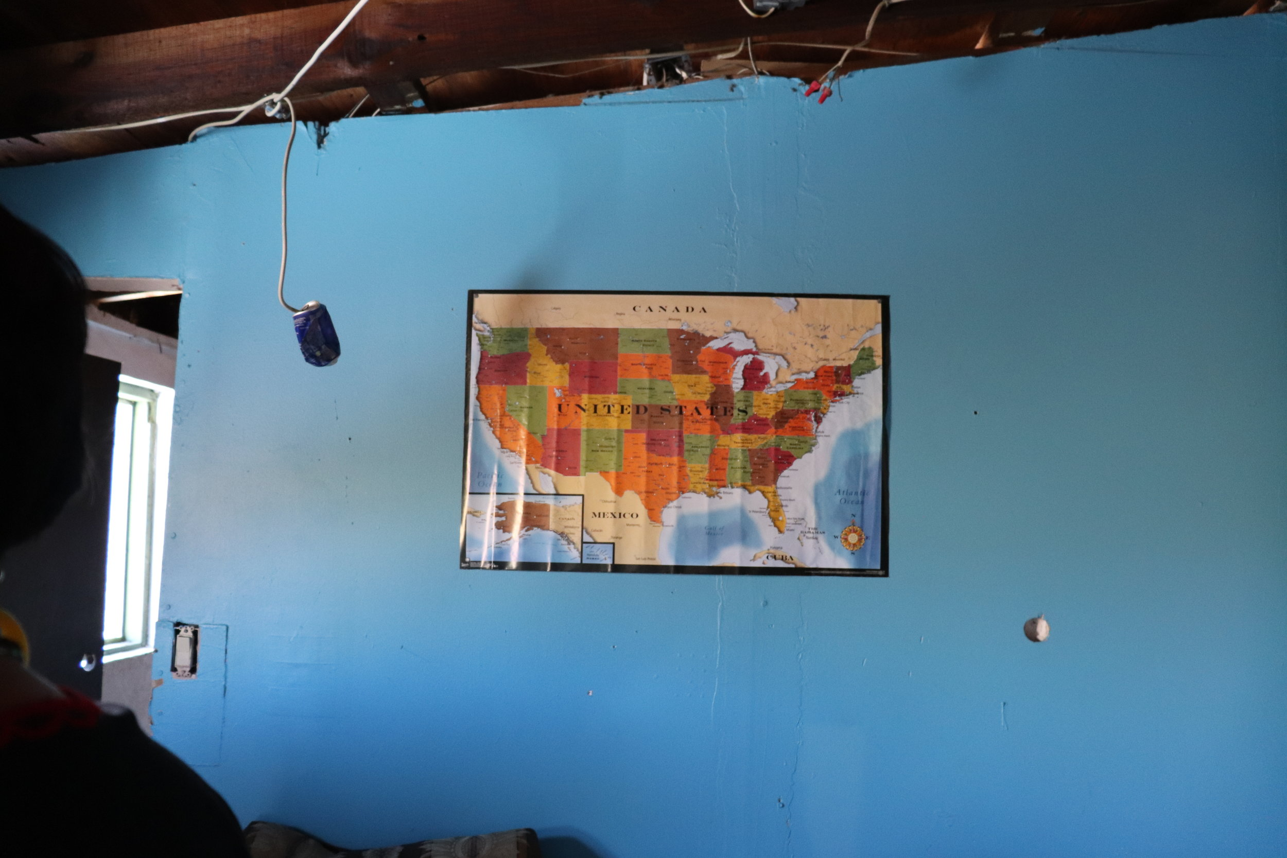 A map of the United States hangs in a common area of La Roca, informing people on how far they have to travel. A lot of them don't know how large the U.S. was until they could view it on a map.