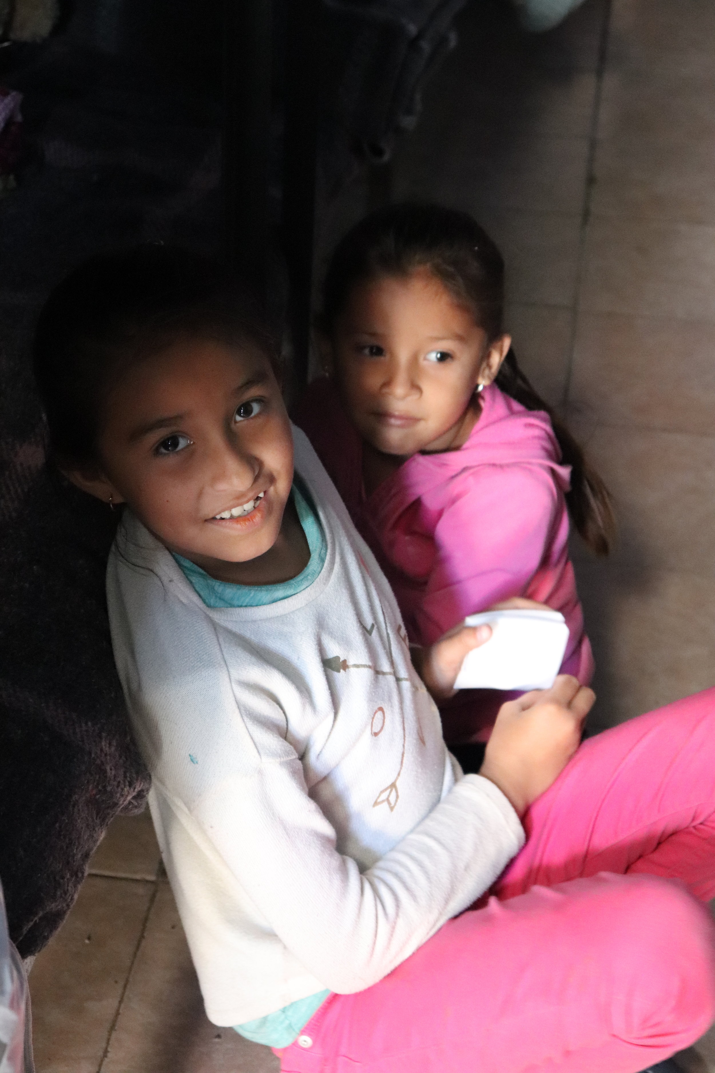 Two young girls who have been at La Roca for over a month.