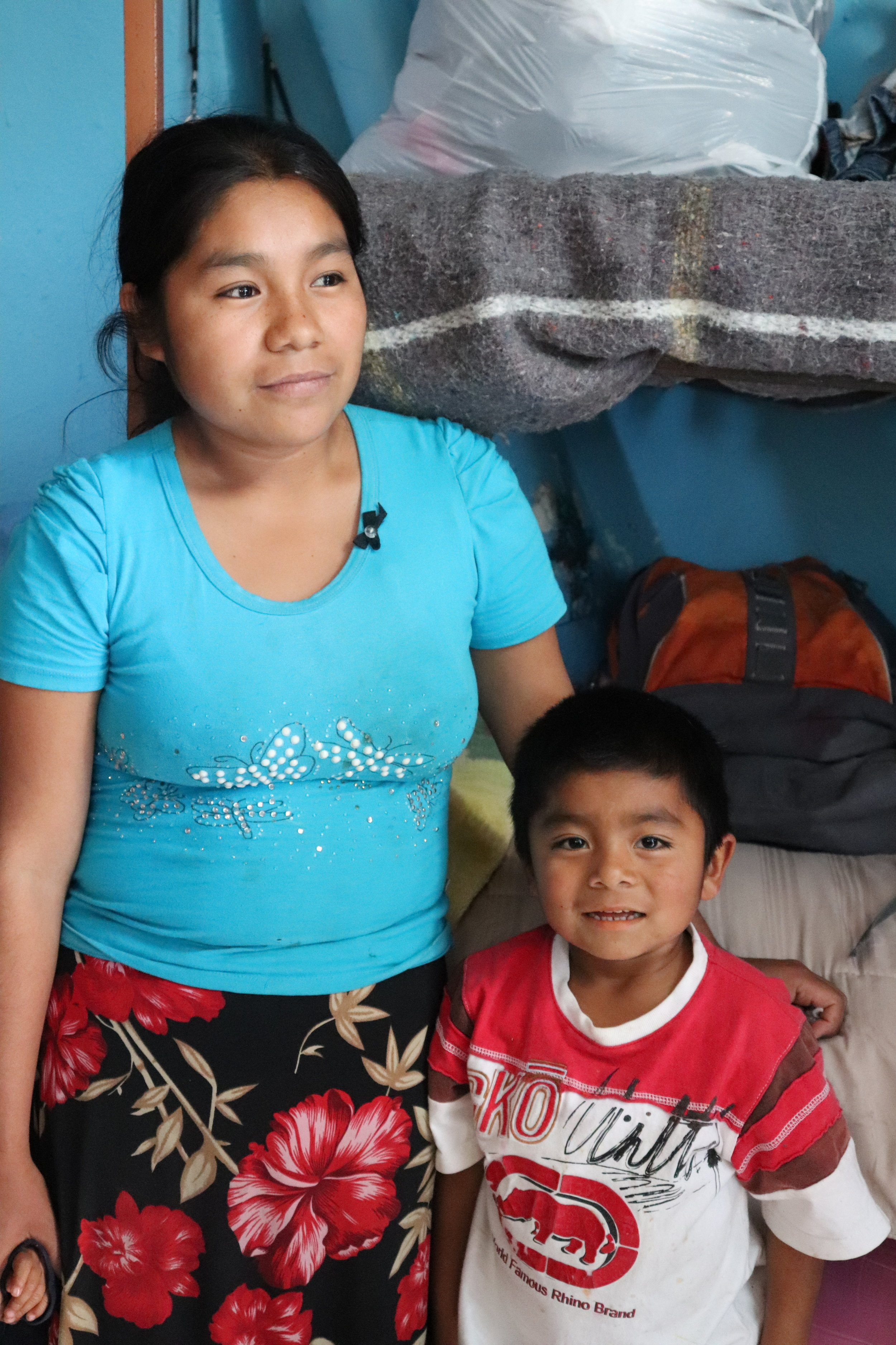 A 23-year-old mother traveling from Guerrero, Mexico. She is pictured with the oldest of her four children.