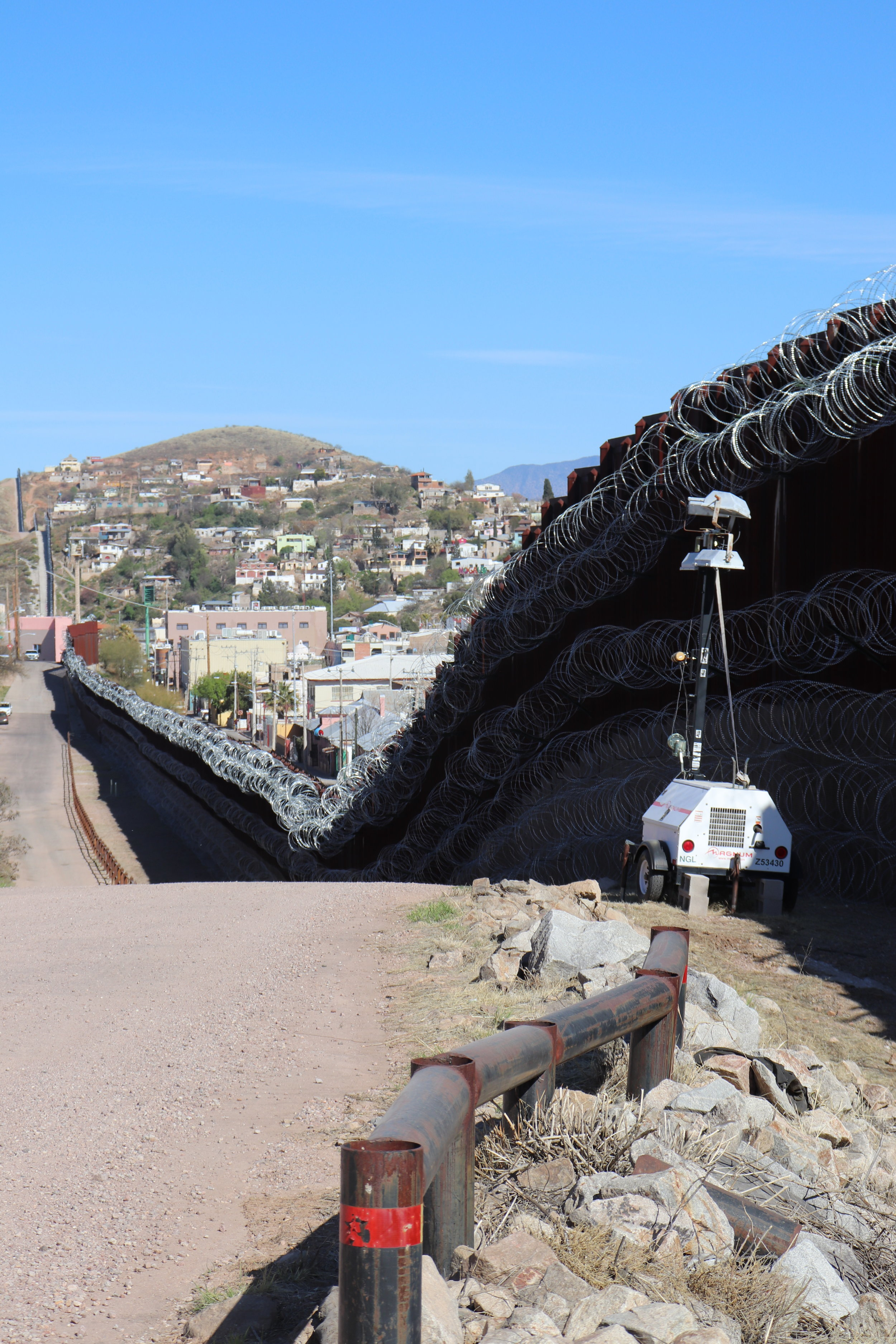 A view of the border wall from the American side. The wire has been added since the 2016 presidential election.