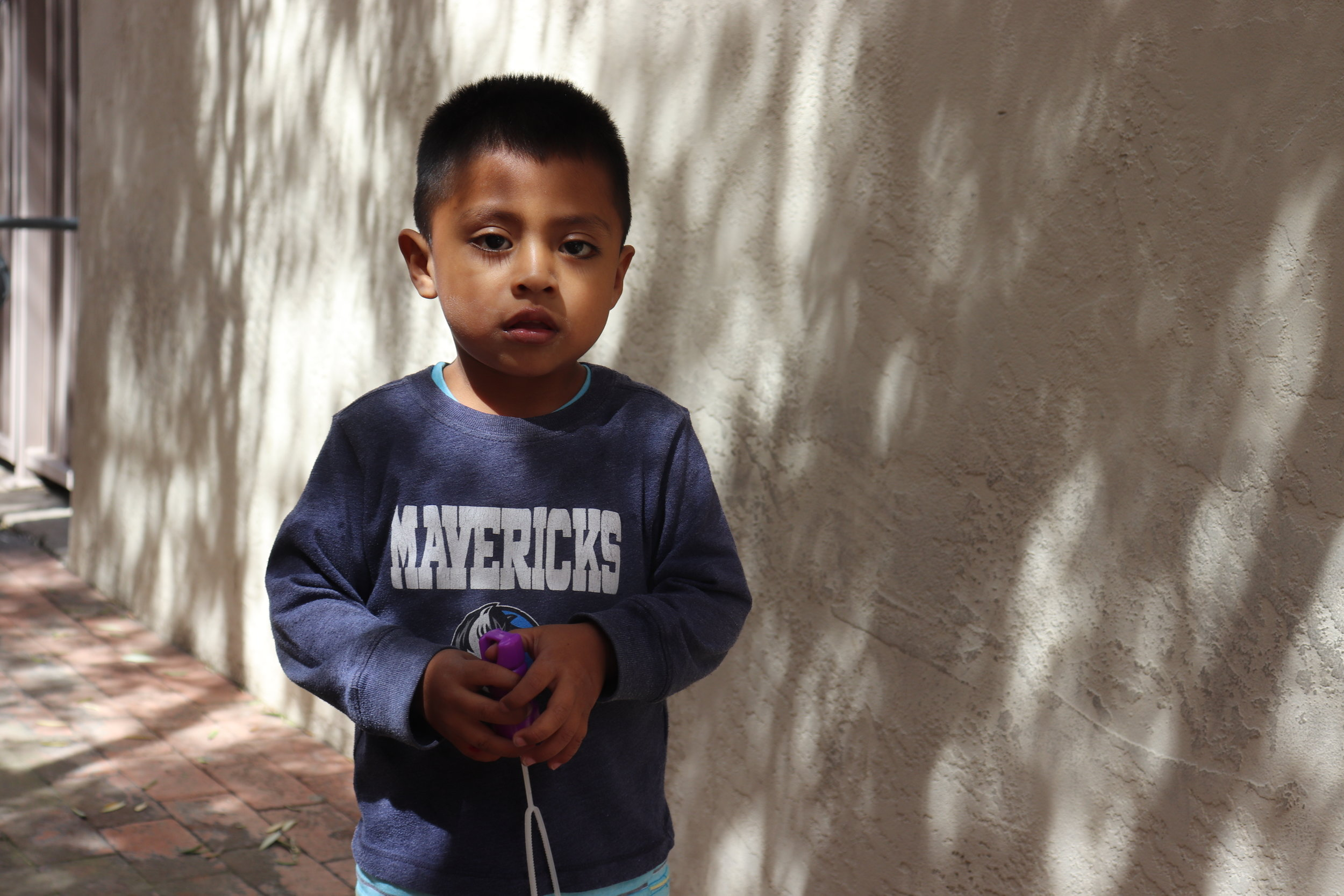 A young boy plays with donated bubbles in the courtyard of The Inn Project. Volunteer opportunities are provided in almost every state, find one near you at welcomingamerica.org