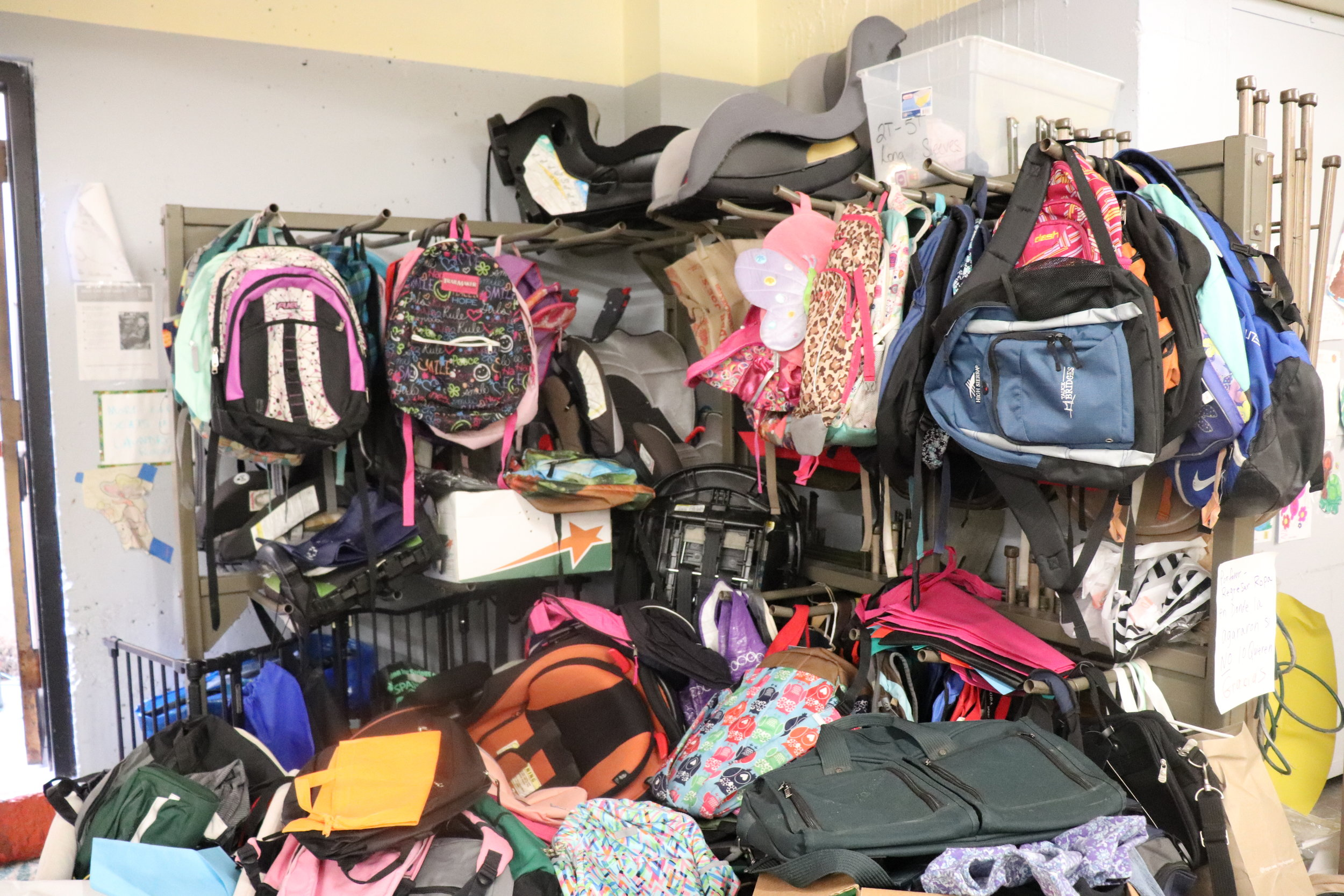 These are donated car seats and backpacks in the entryway of The Inn Project. Backpacks for migrants on either side of the border are very important. Others have been robbed when carrying their belongings in plastic bags since they are noticeably immigrants. The Inn Project currently needs children's clothing, size medium adult clothing, shoes, backpacks, towels and laundry supplies. Donations are always accepted at www.theinnumc.org