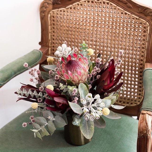 Kathryn's table arrangements with protea, strilingia, leucadendron and native foliages | 📸 by @mayflowerweddingphotography  #stonebarnweddings #proteabouquet #nativebouquet #tablearrangement #perthbrides #perthbridal #protea