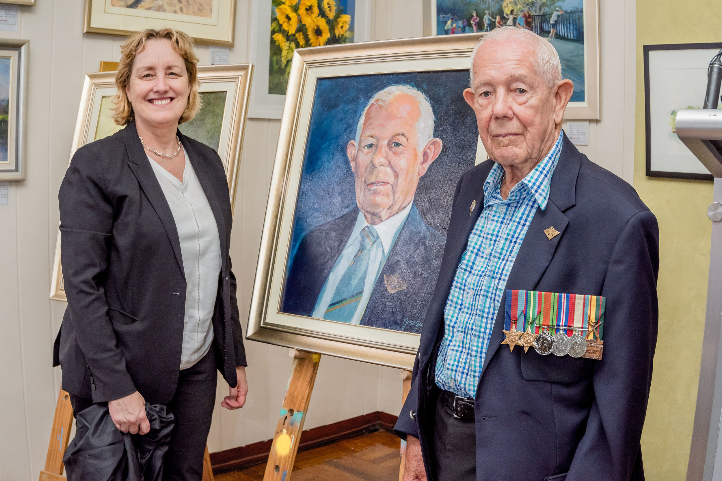 Unveiling the portrait of WWII Veteran Reginald James Chard by himself and SLHD CE Dr. Teresa Anderson.jpg