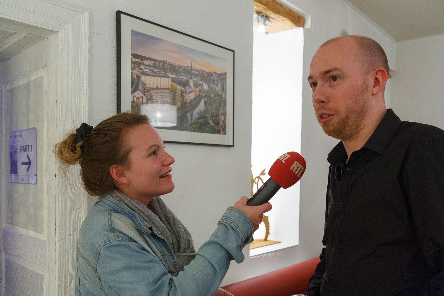 Interview with RTL Radio at the first solo exhibition by Luxembourg Landscape Photographer Christophe Van Biesen at the Brasserie Beim Siggy in Luxembourg City
