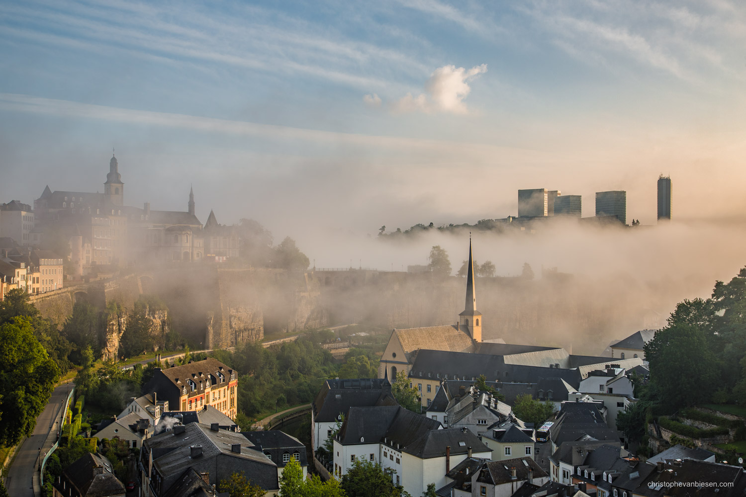 Photography Workshop in Luxembourg - Fog lifts as the sun rises over Luxembourg City's Grund on a summer day - Dawn above the Sea of Fog - Photography by Christophe Van Biesen - Landscape and Travel Photographer