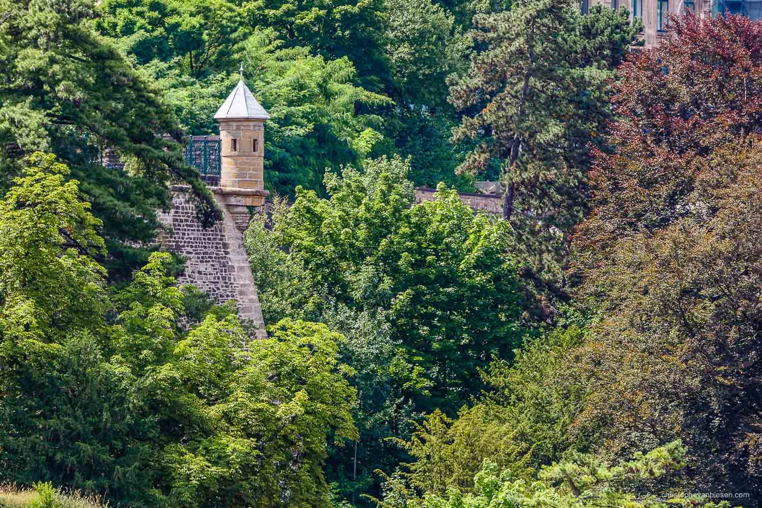 Summer in Luxembourg - One of Luxembourg City's Spanish Towers peeking out of the surrounding trees - The City's Watchtowers II